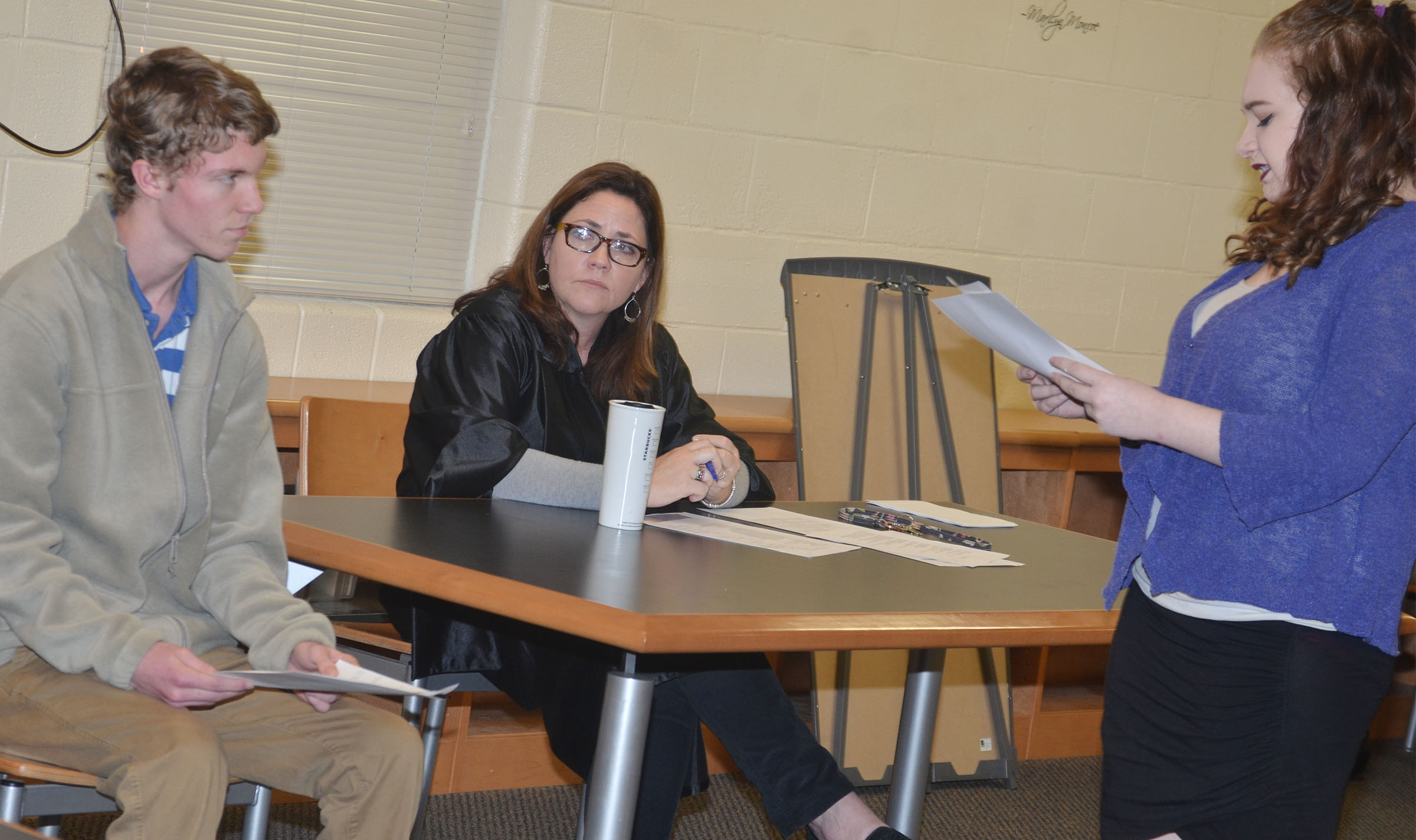 CHS sophomore Leslie McKenzie, at right, portraying a defense attorney, questions classmate Payton Reynolds, a witness in the case, as judge Susan Dabney listens.