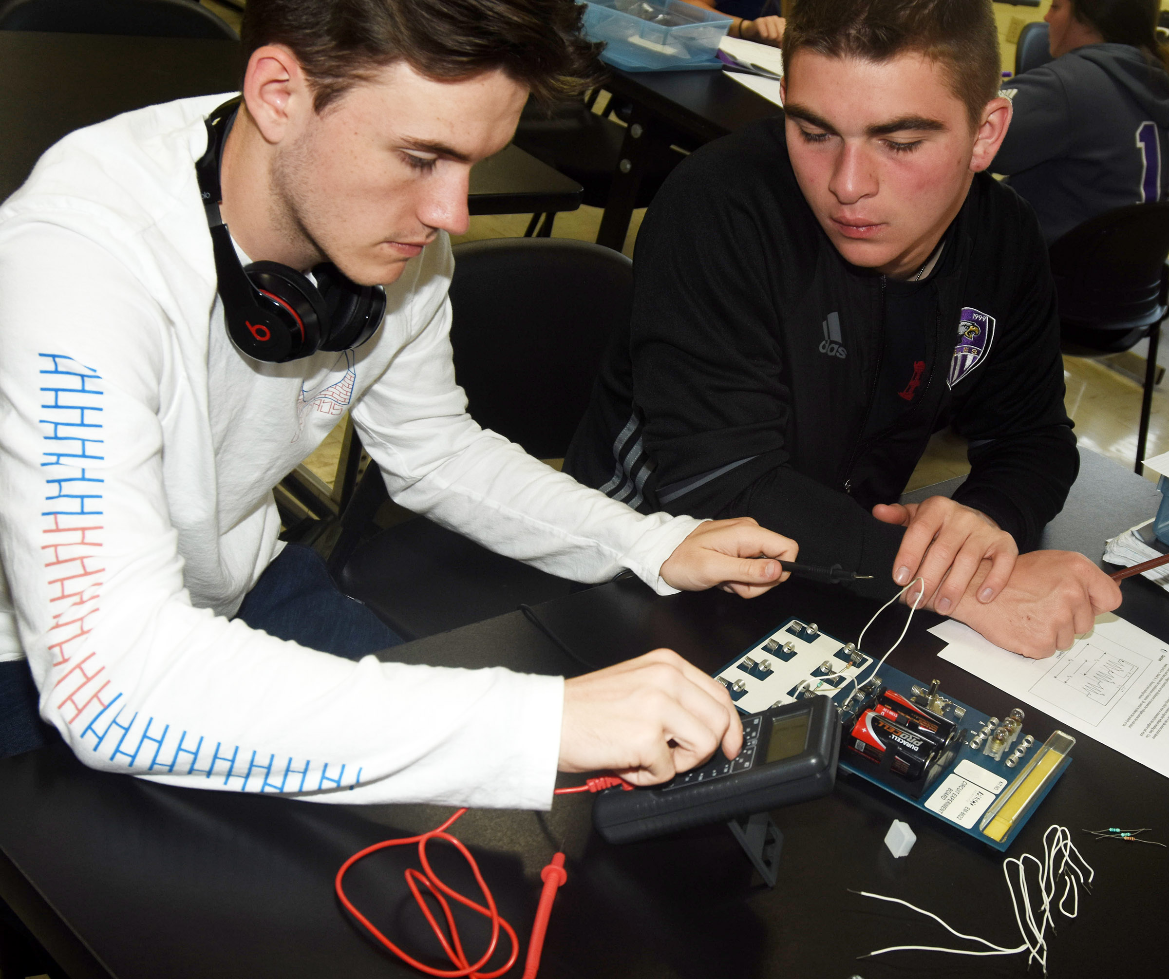 CHS seniors Jackson Hunt, at left, and Cass Kidwell work on their electricity lab exercise.