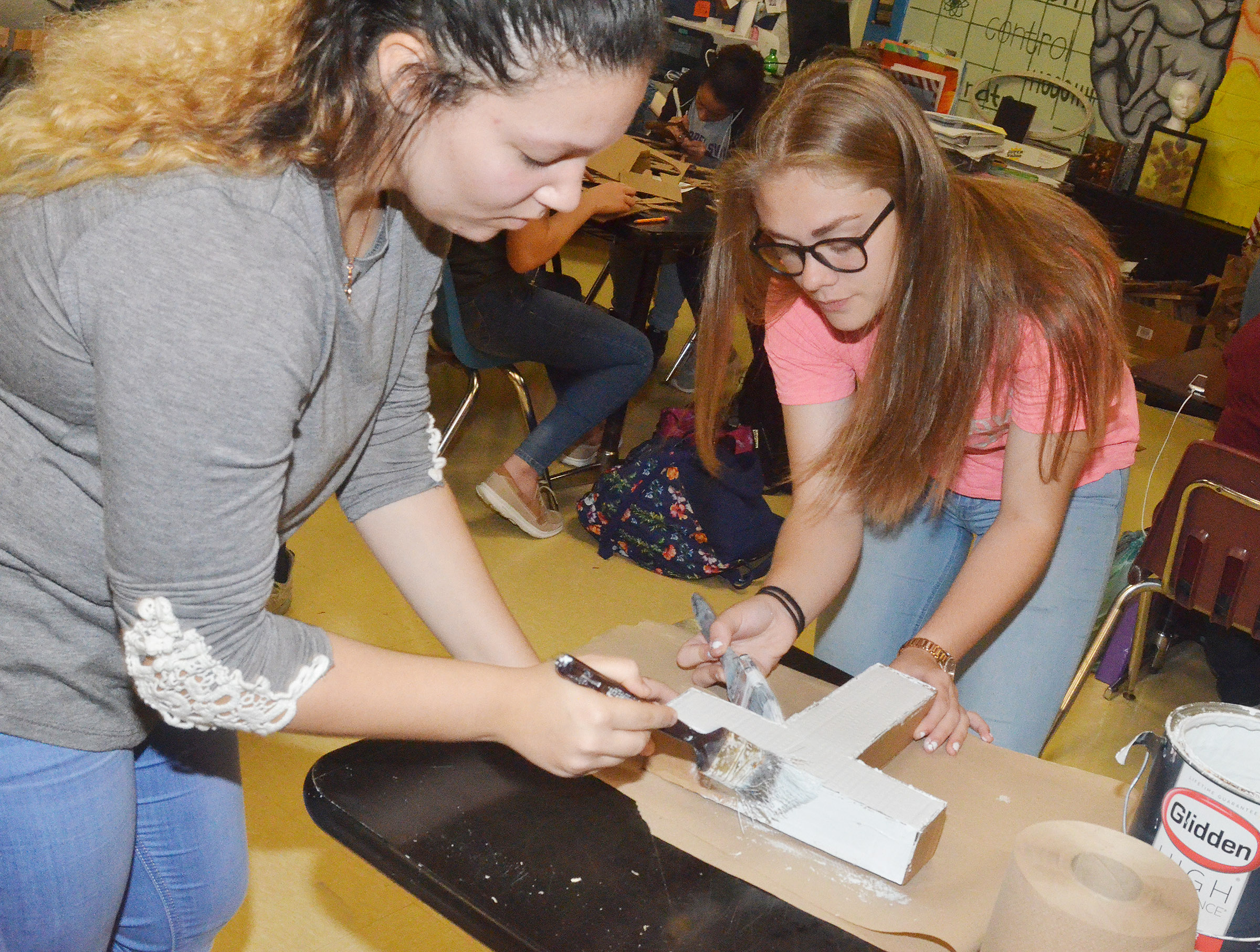 CHS freshmen Tierra Bridgewater, at left, and Emily Kerns paint their letter.