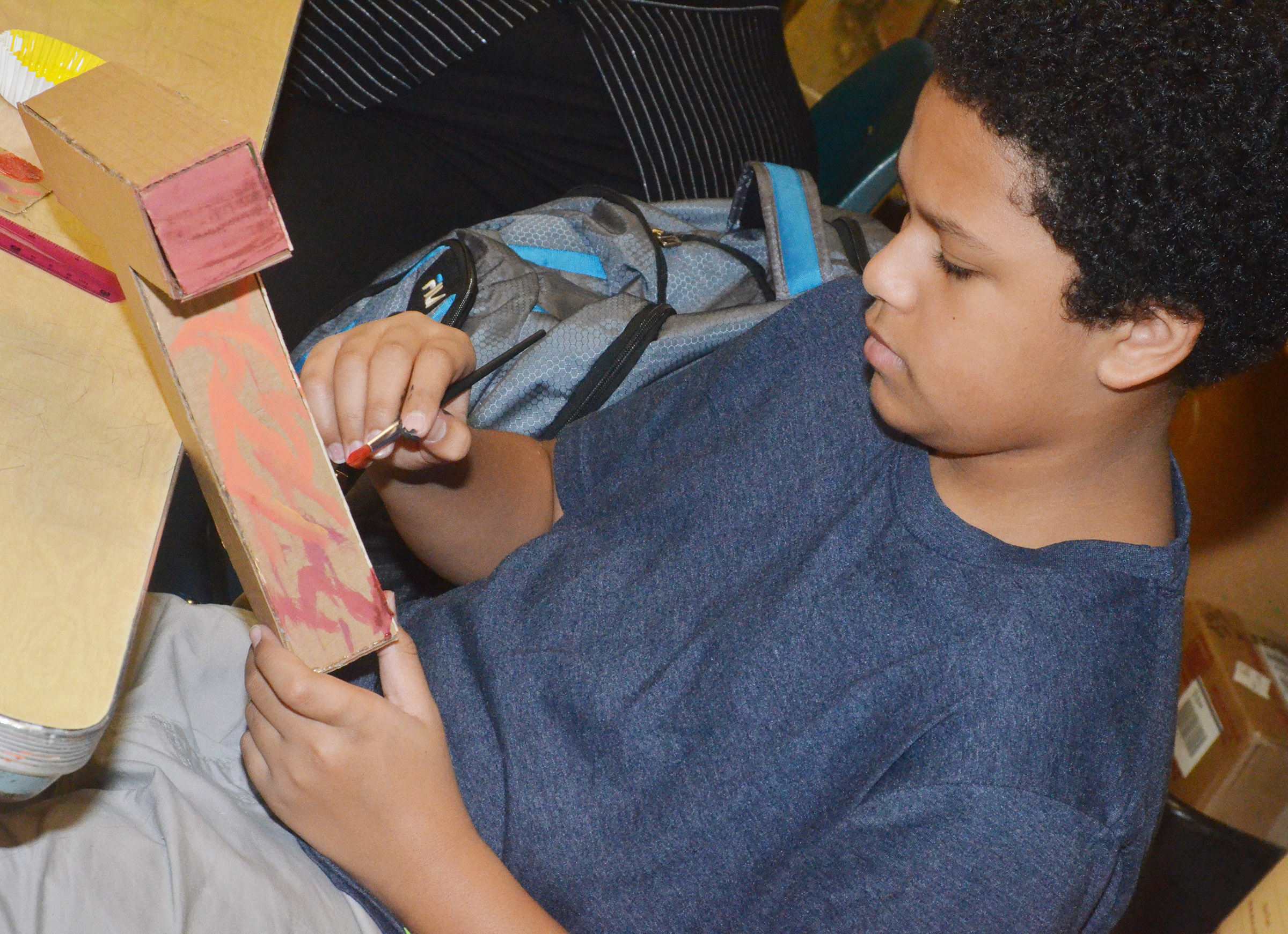 "Campbellsville Middle School eighth-grader Tezon Mitchell paints his ""T."""