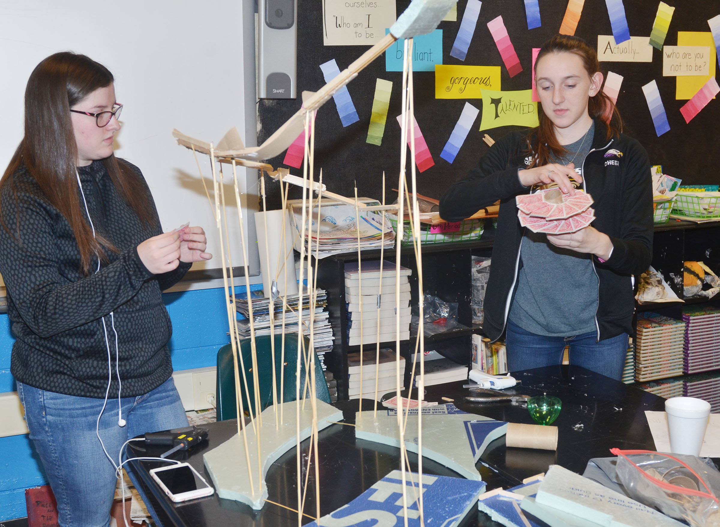 CHS freshmen Alli Wilson, at left, and Zoe McAninch work together to build their ball dropper.
