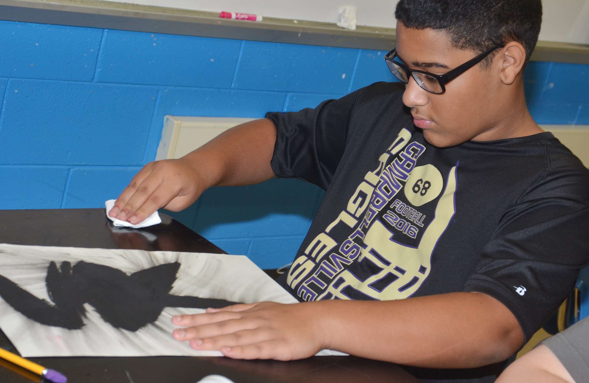 CHS freshman Tyreece Washington rubs his drawing.