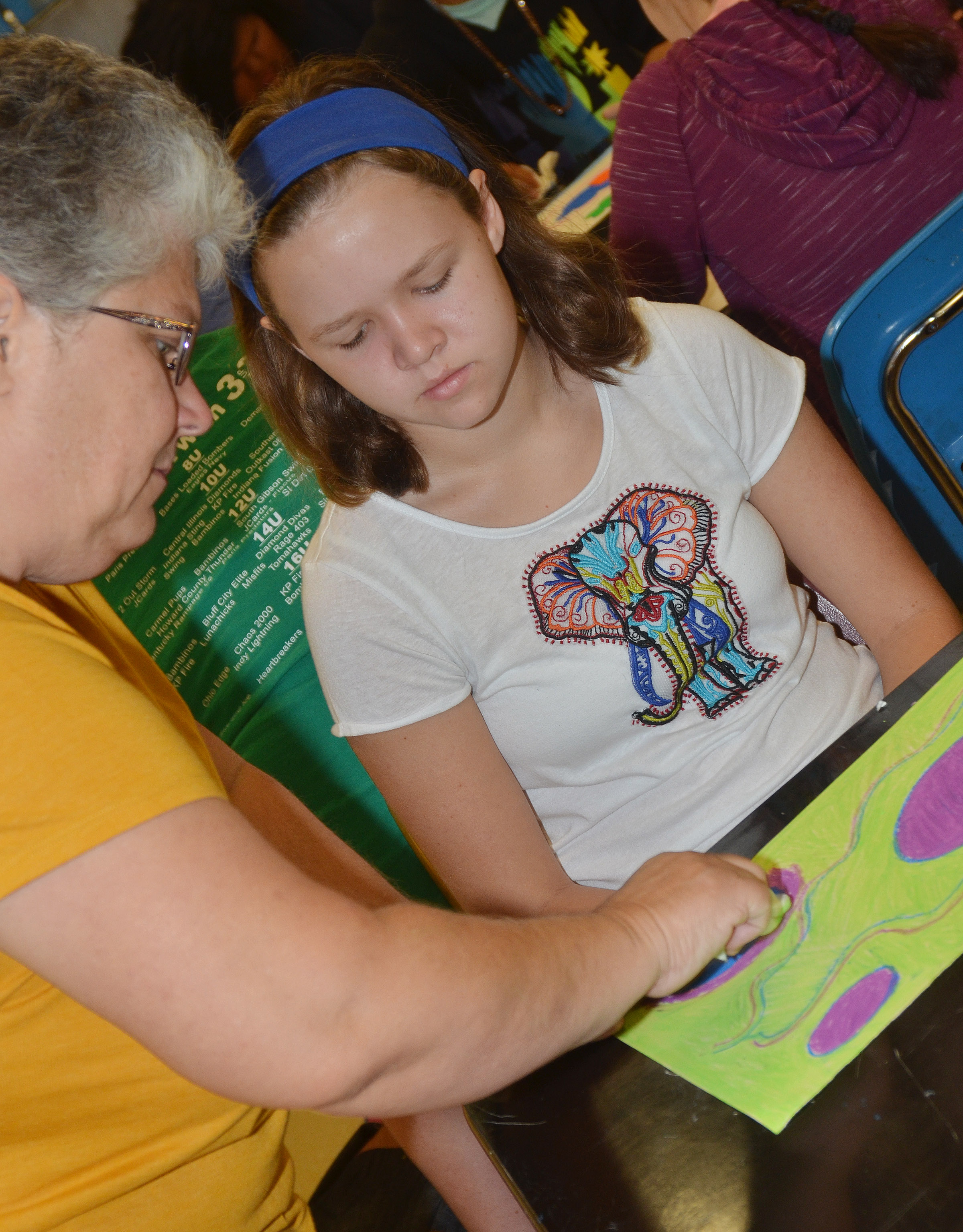 CHS art teacher Jo Ann Harris helps Campbellsville Middle School seventh-grader MaCayla Falls with her chalk pastel drawing.