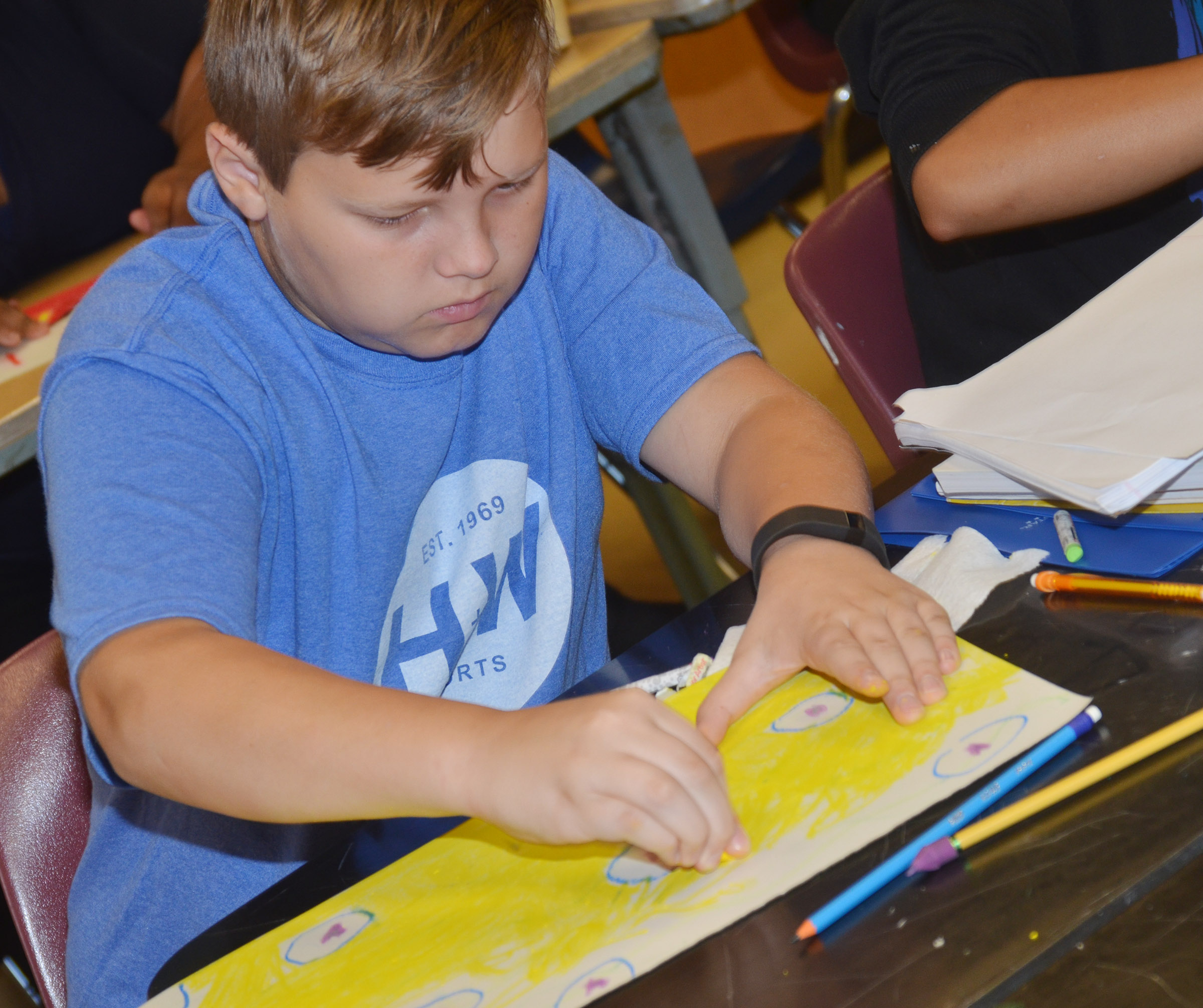 Campbellsville Middle School sixth-grader Hunter Falls colors his drawing.