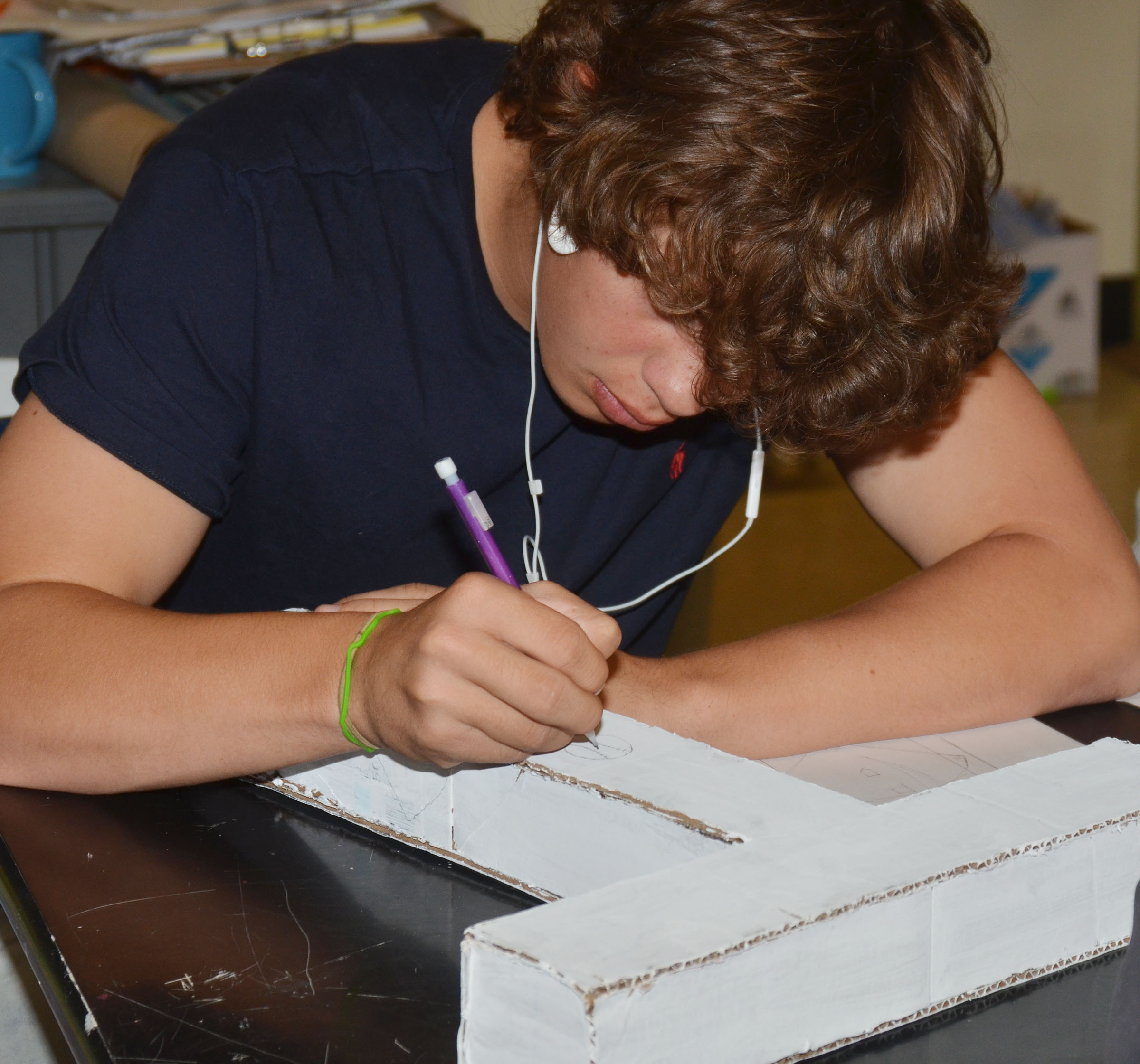 CHS sophomore Treyce Mattingly works on his final art project, a 3D letter.