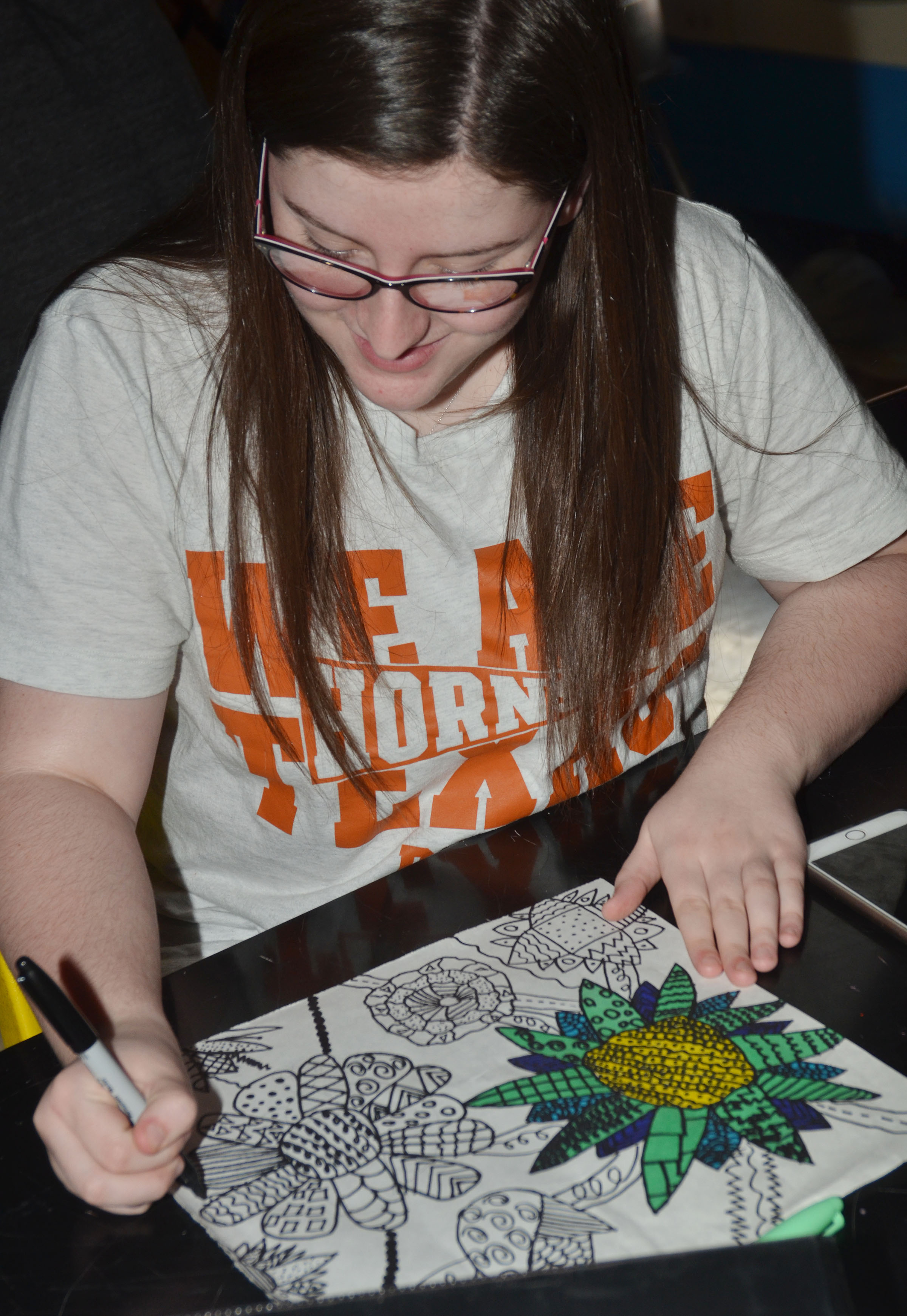 CHS freshman Alli Wilson works on her final art project, a drawing with markers.