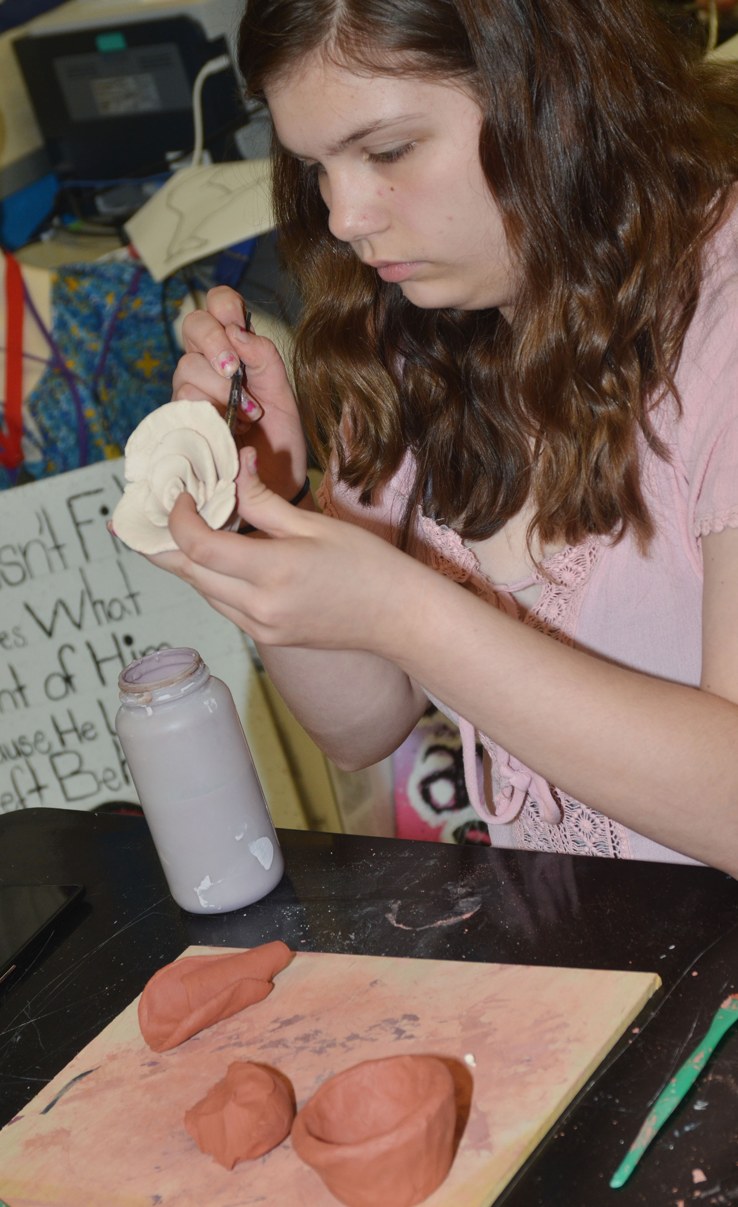 CHS freshman Shelby Hunt works on her final art project, a clay figure.