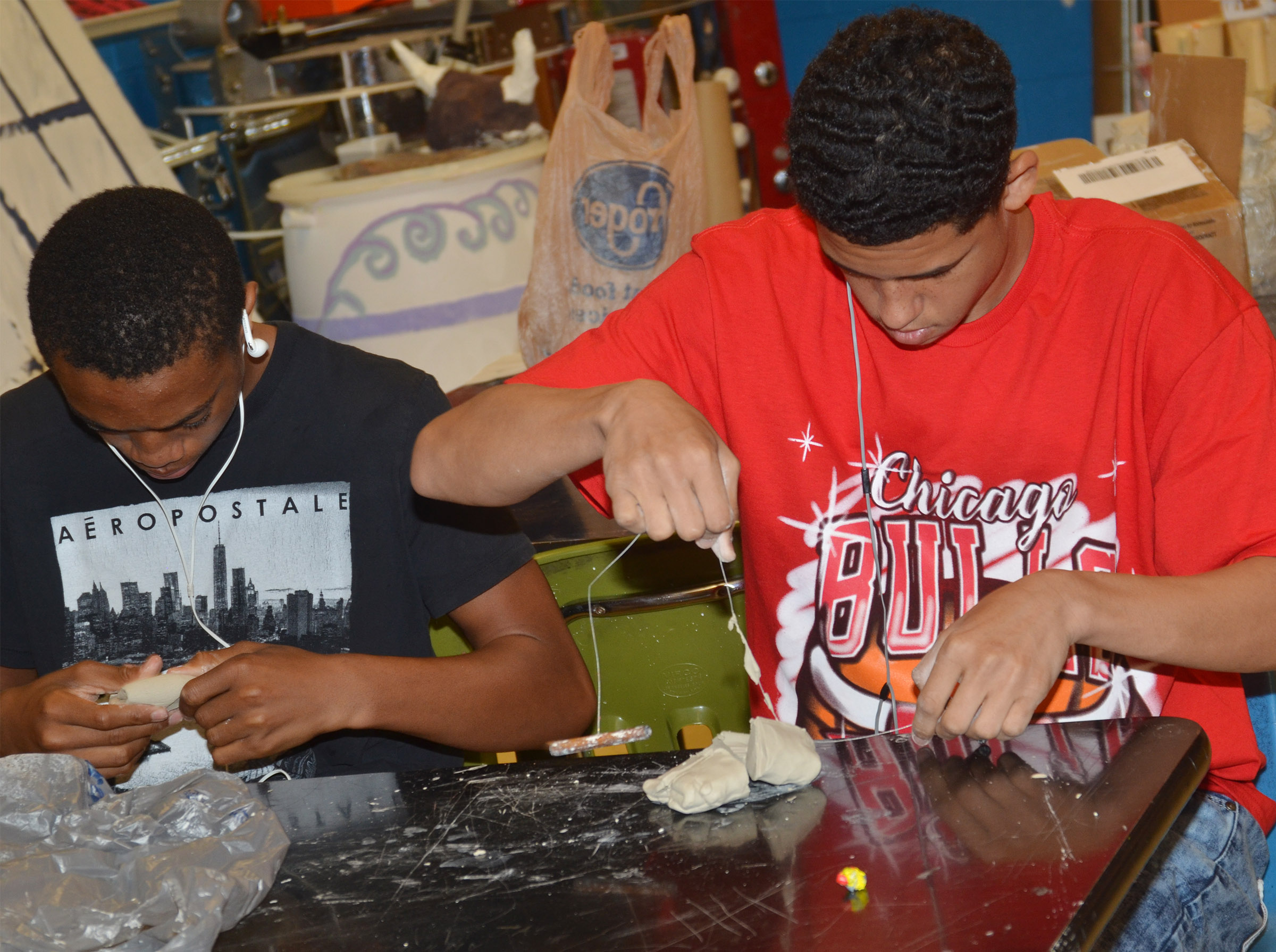 CHS freshmen Lathan Cubit, at left, and Mikael Vaught shape their clay.