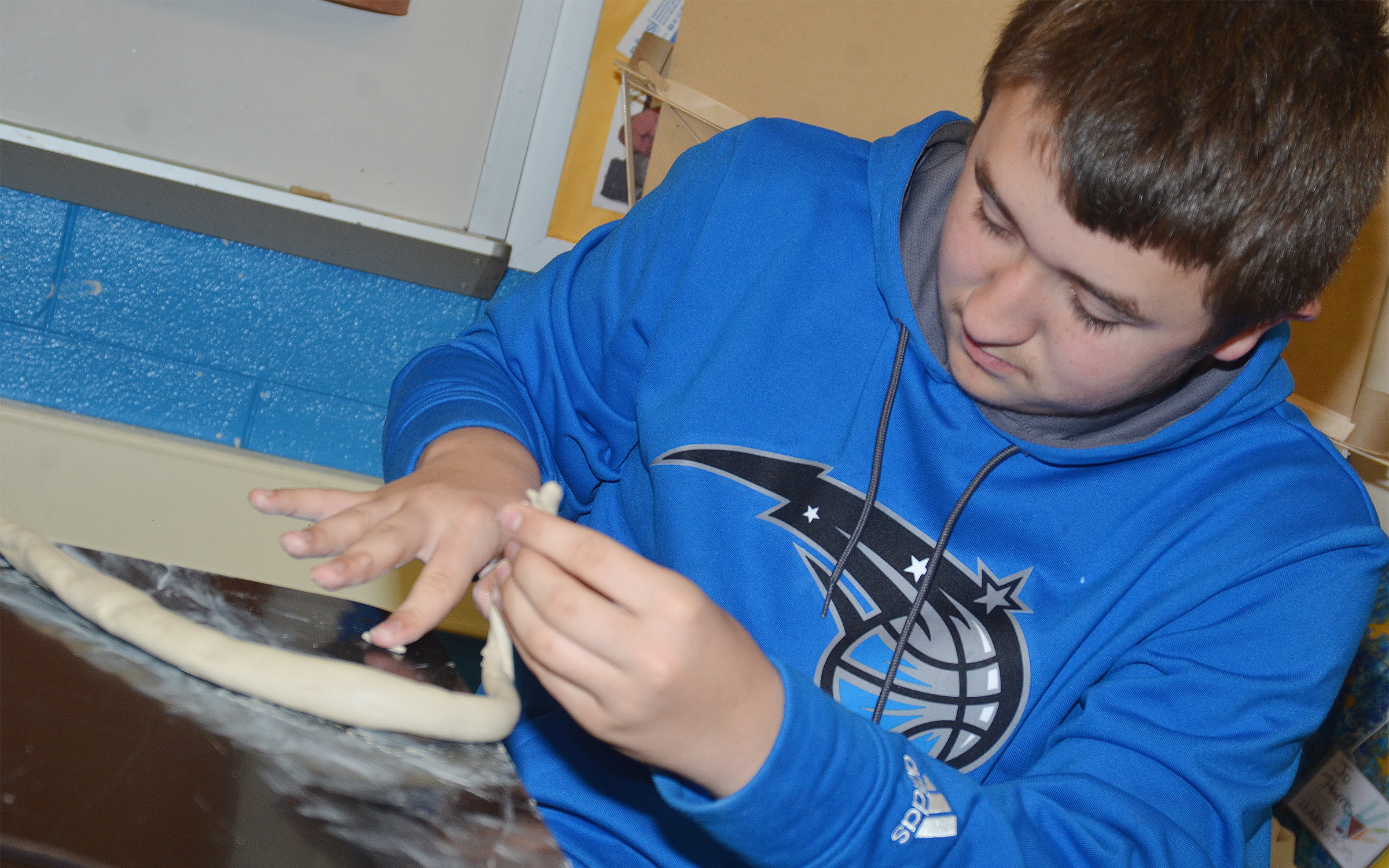 Campbellsville Middle School eighth-grader Zachary Shaw shapes his clay.