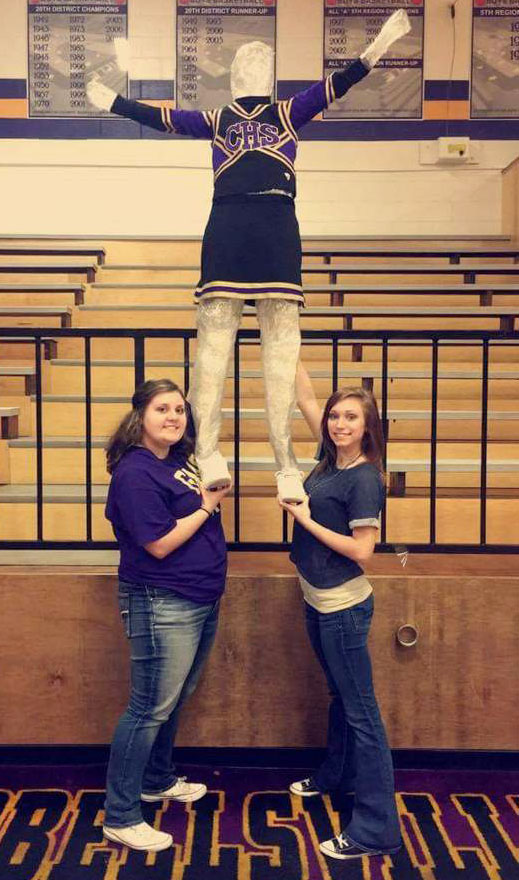 CHS sophomore Andrea Bryant, at left, and junior Jasmine Coomer pose with their tape sculpture.