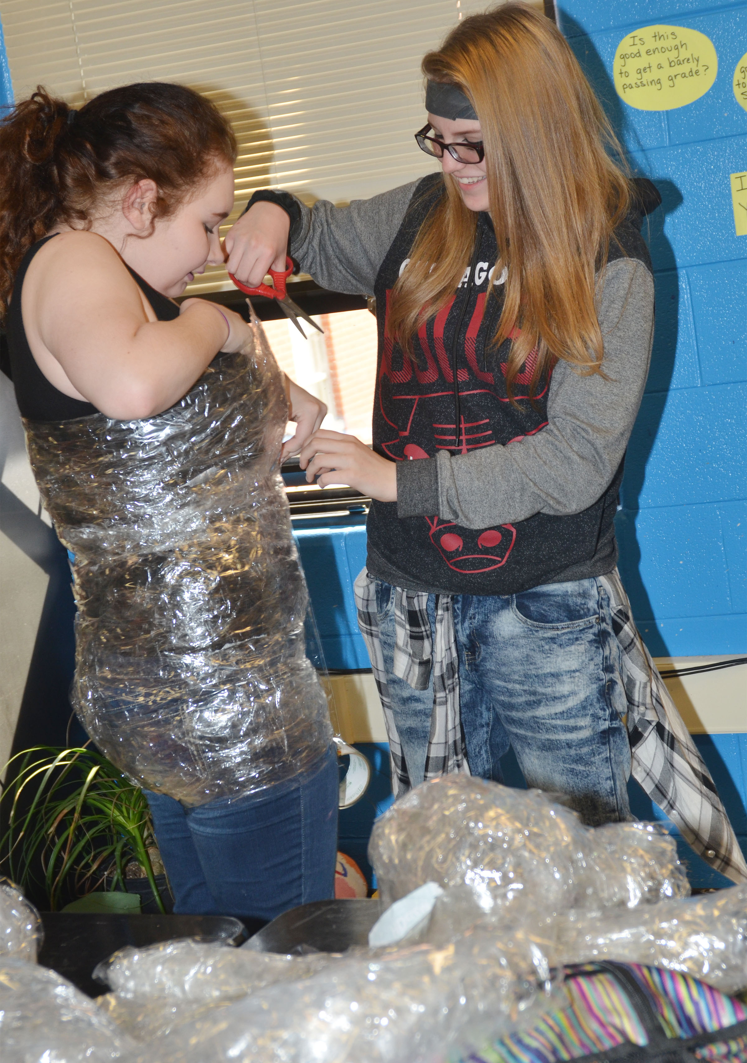 CHS sophomore Jade Packard cuts classmate Leslie McKenzie out after she was taped.