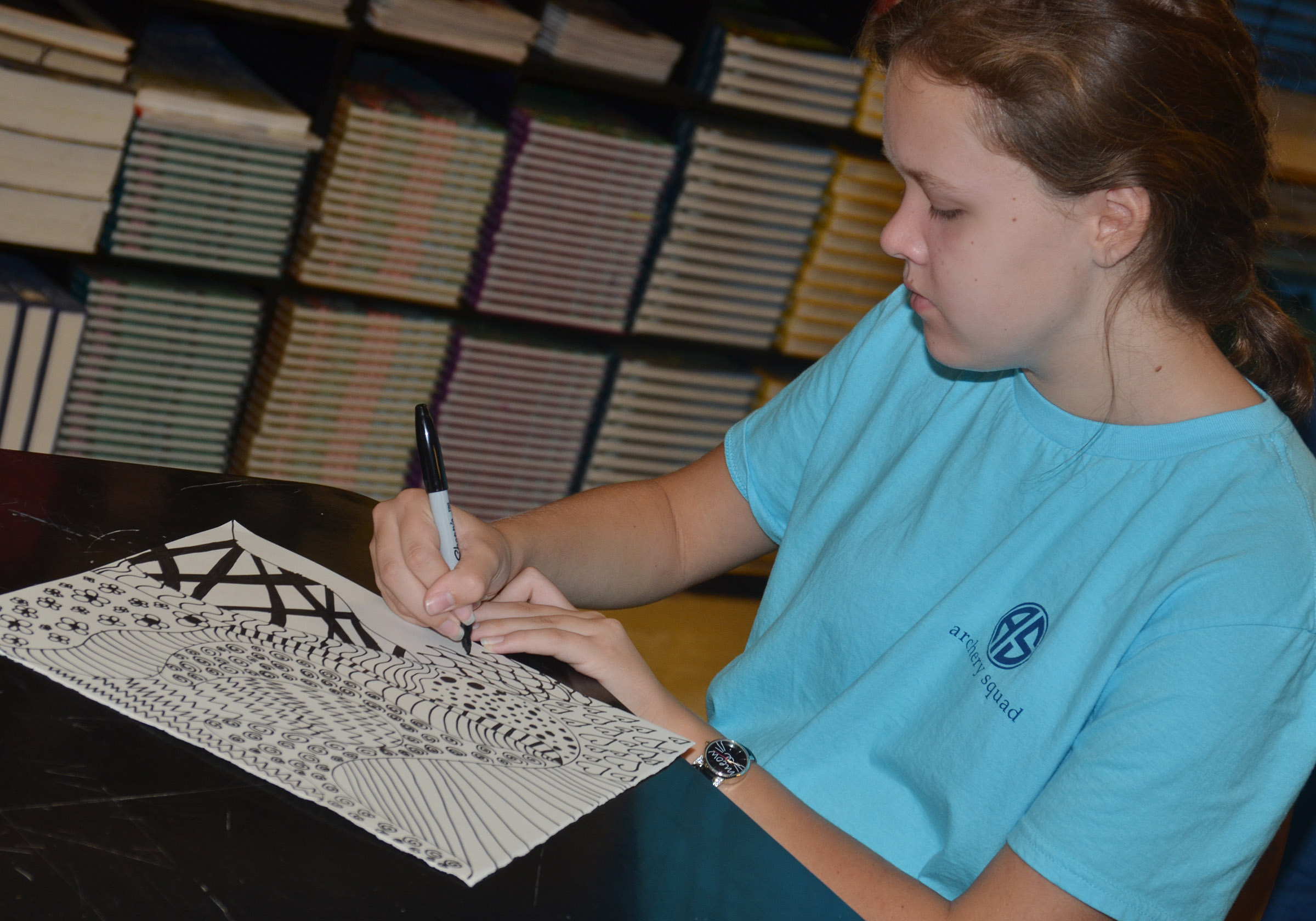 Campbellsville Middle School seventh-grader MaCayla Falls outlines her zentangle.