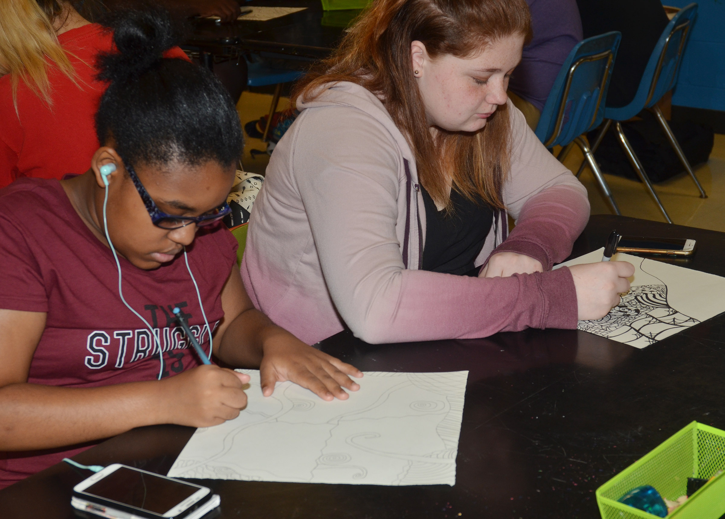 CHS freshman Jasmine Mitchell, at left, and sophomore Ally Jefferson work on their zentangle designs.