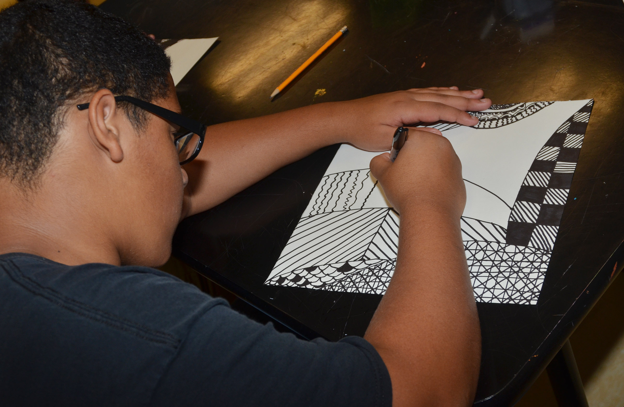 CHS freshman Tyreece Washington works on his zentangle design.