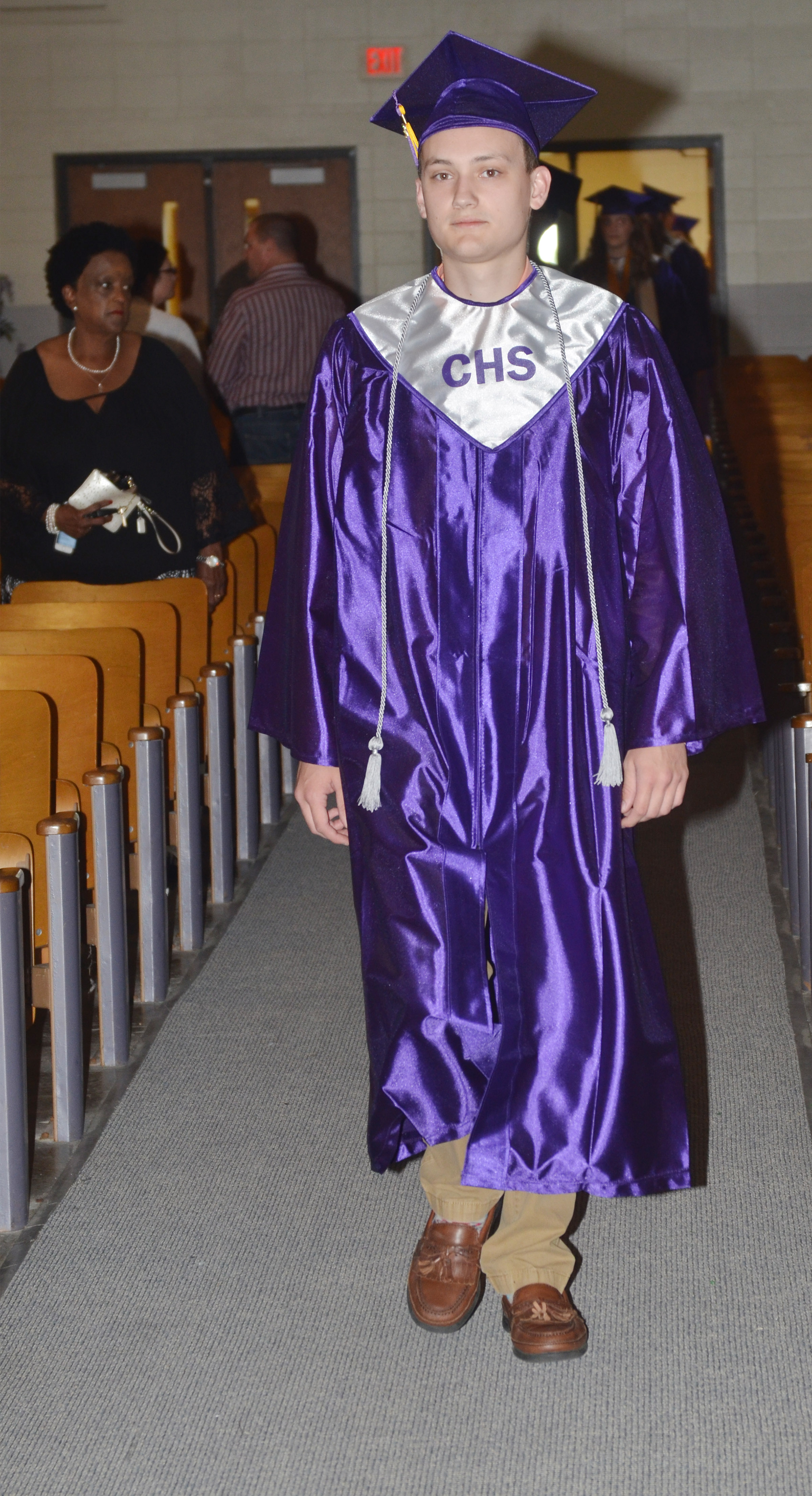 CHS senior Jonathan Rakes walks in Hamilton Auditorium for the baccalaureate ceremony.