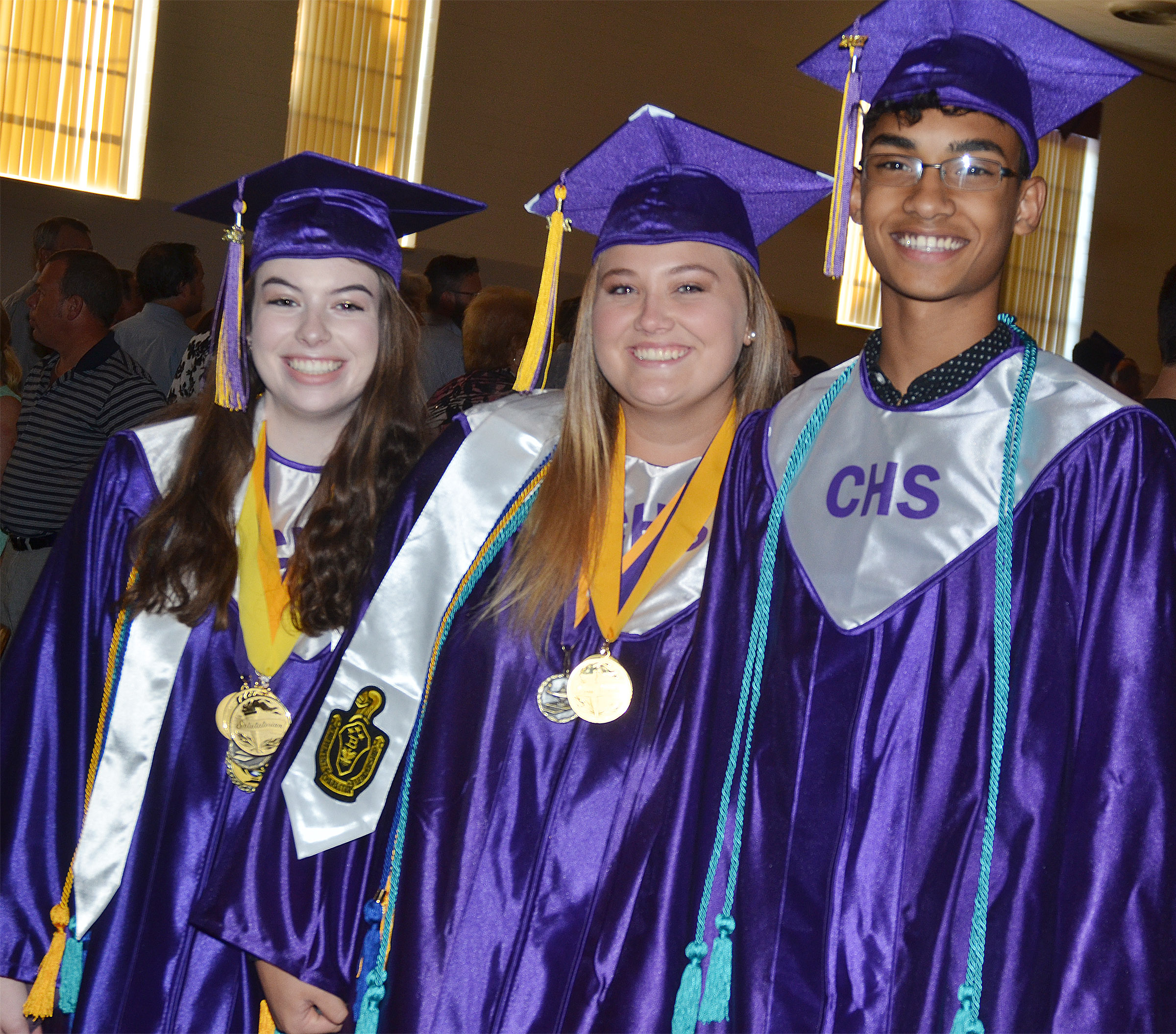 From left, CHS seniors Laura Lamb, Brenna Wethington and Daniel Silva smile as they wait for the baccalaureate ceremony to begin.