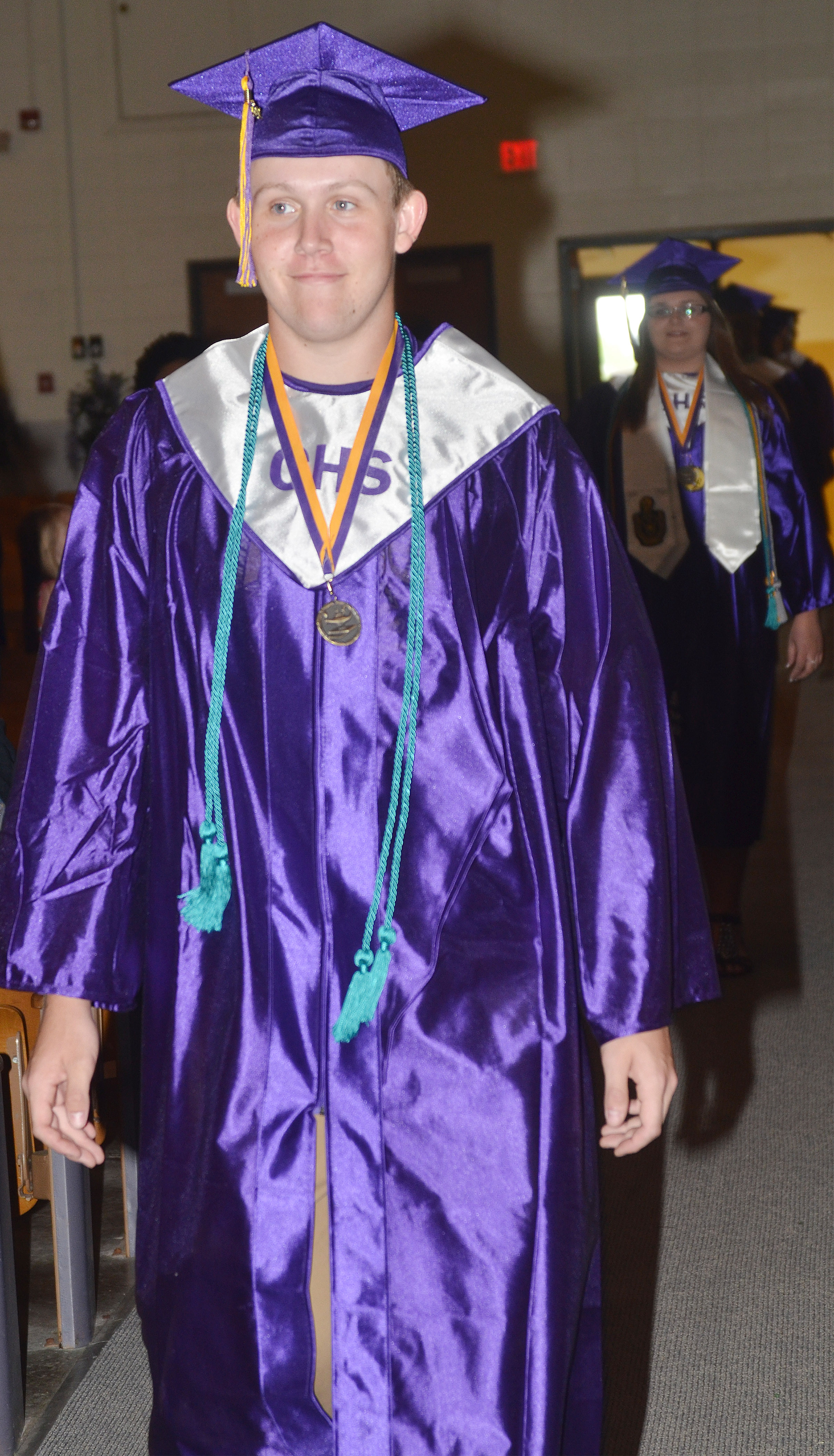 CHS senior Jared Brewster walks in Hamilton Auditorium for the baccalaureate ceremony.