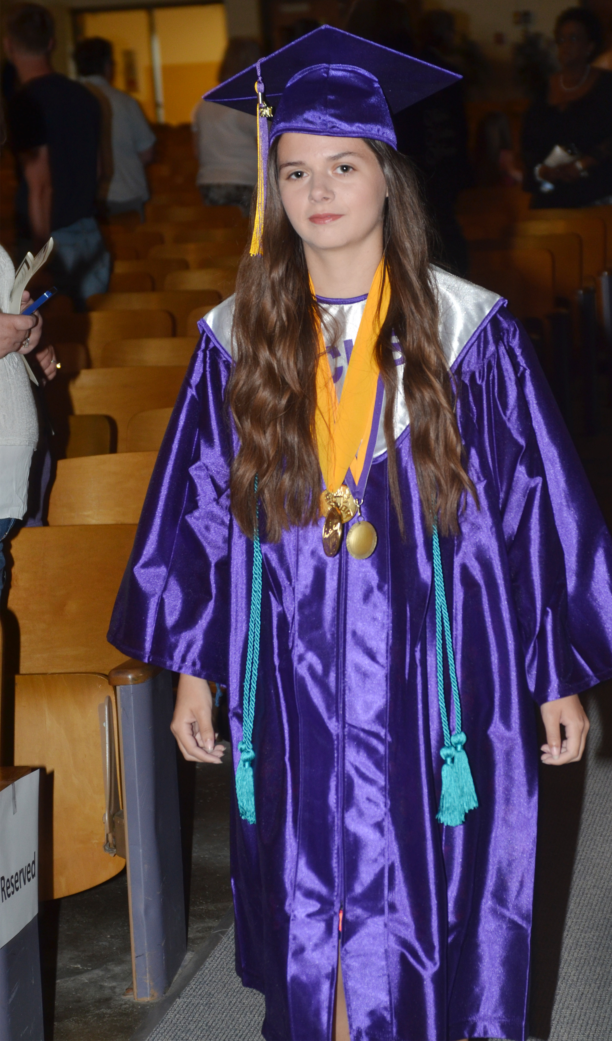 CHS senior Shauna Jones walks in Hamilton Auditorium for the baccalaureate ceremony.