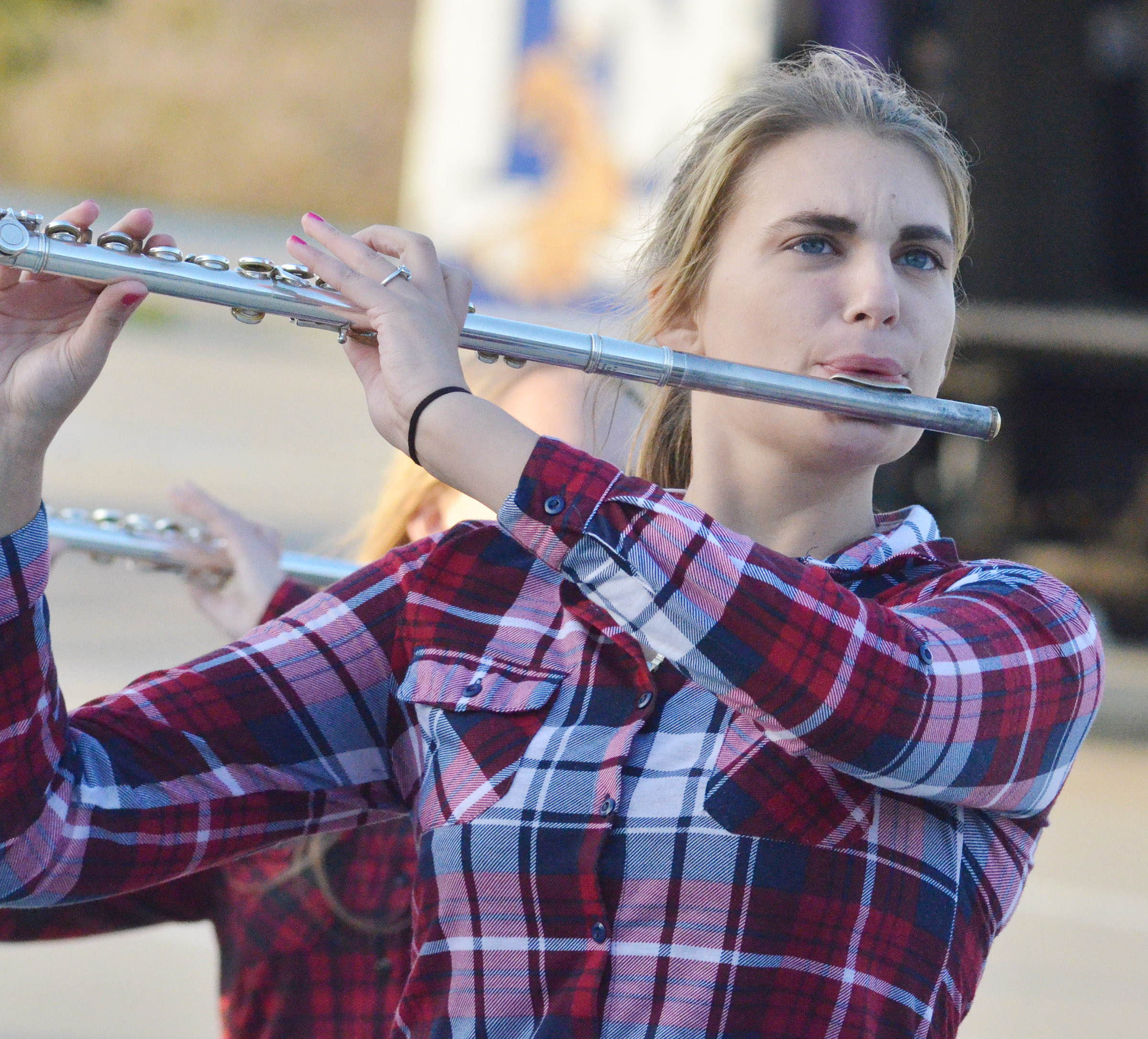 CHS senior Tiffany Kane plays flute during the last practice of the season.