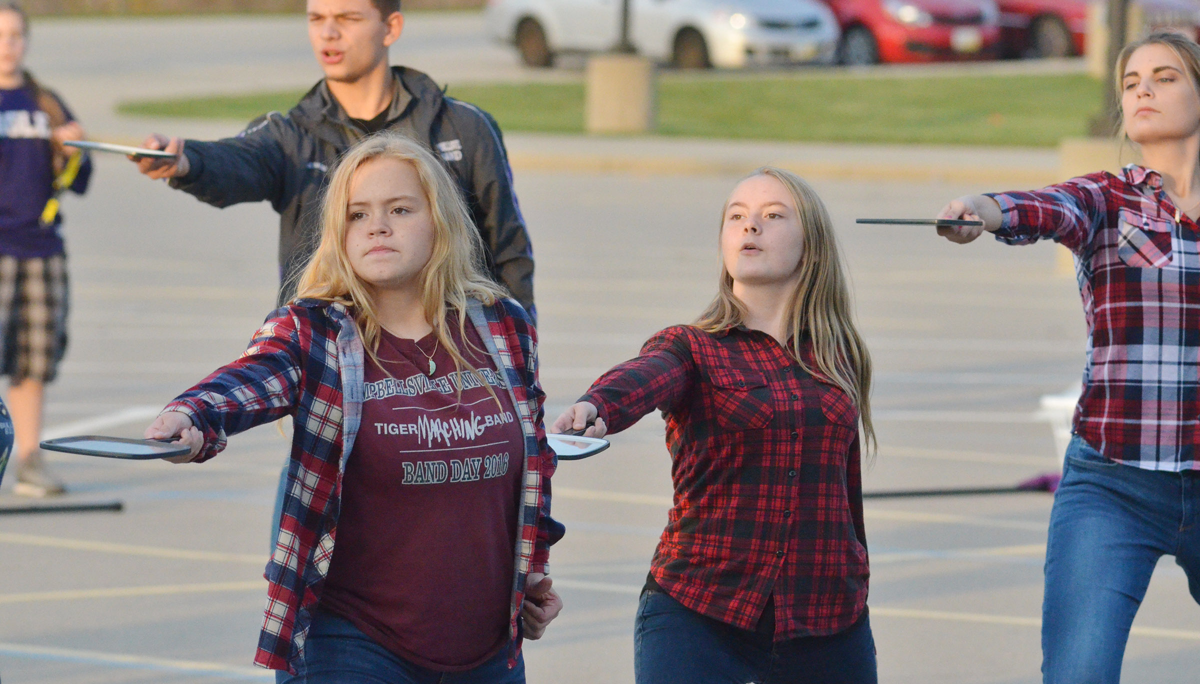 From left, CHS freshmen Riley Rainwater and Emily Hayden and senior Tiffany Kane perform during the last practice of the season.