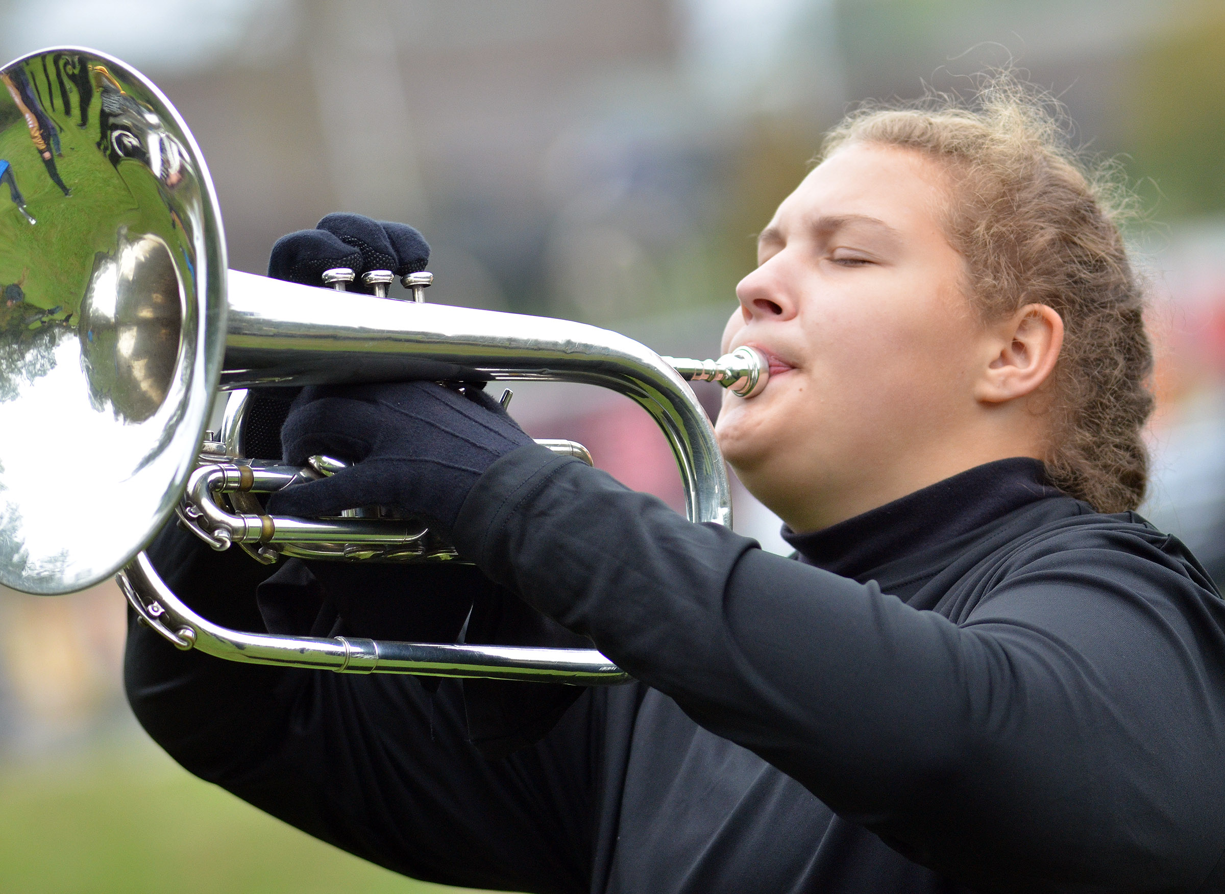 CHS sophomore Abie Angel plays horn in semi-finals competition.