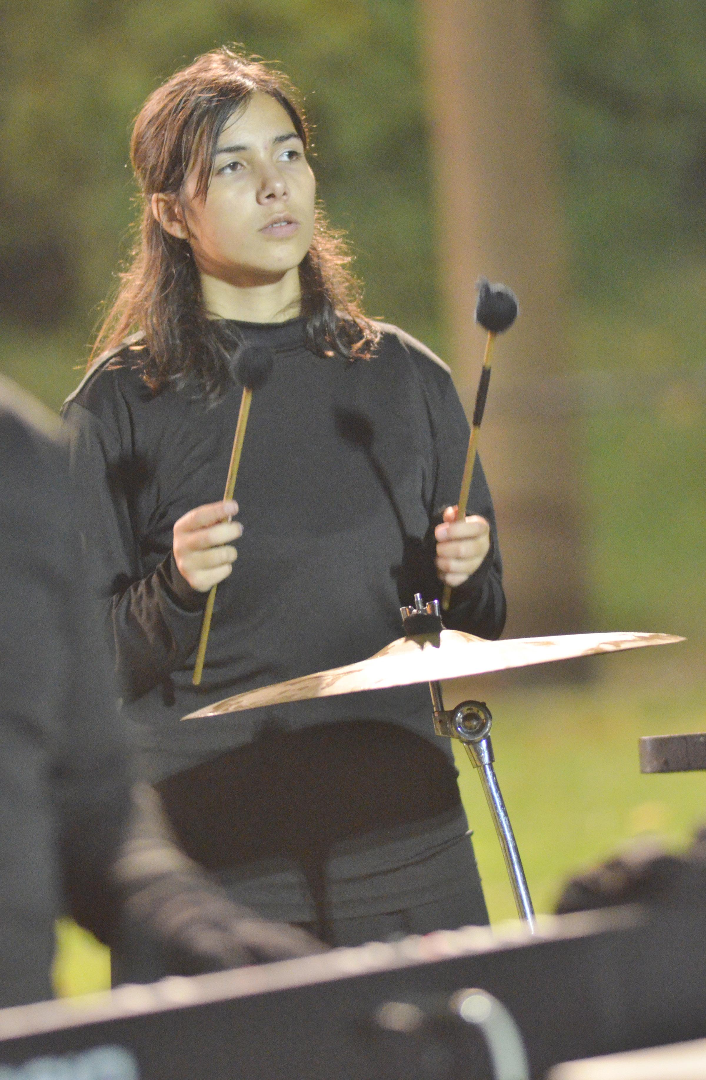 CHS junior Celeste Hassman plays percussion in finals competition.