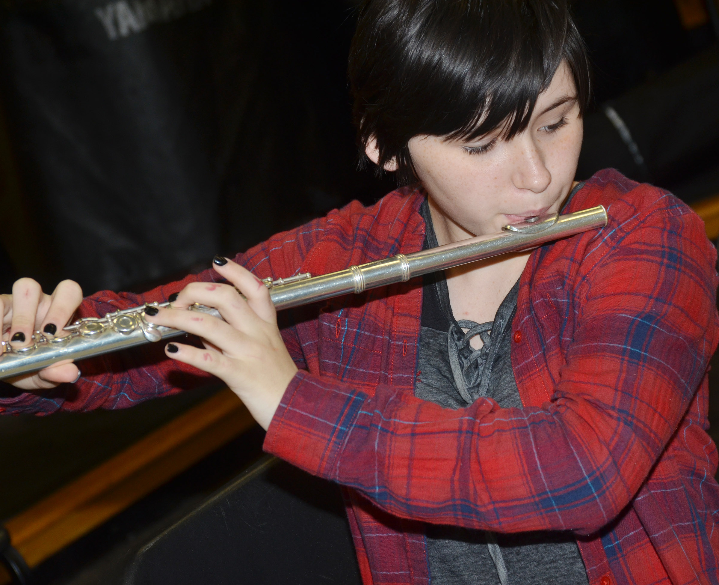 CES sixth-grader Kaylin Forbis plays flute.