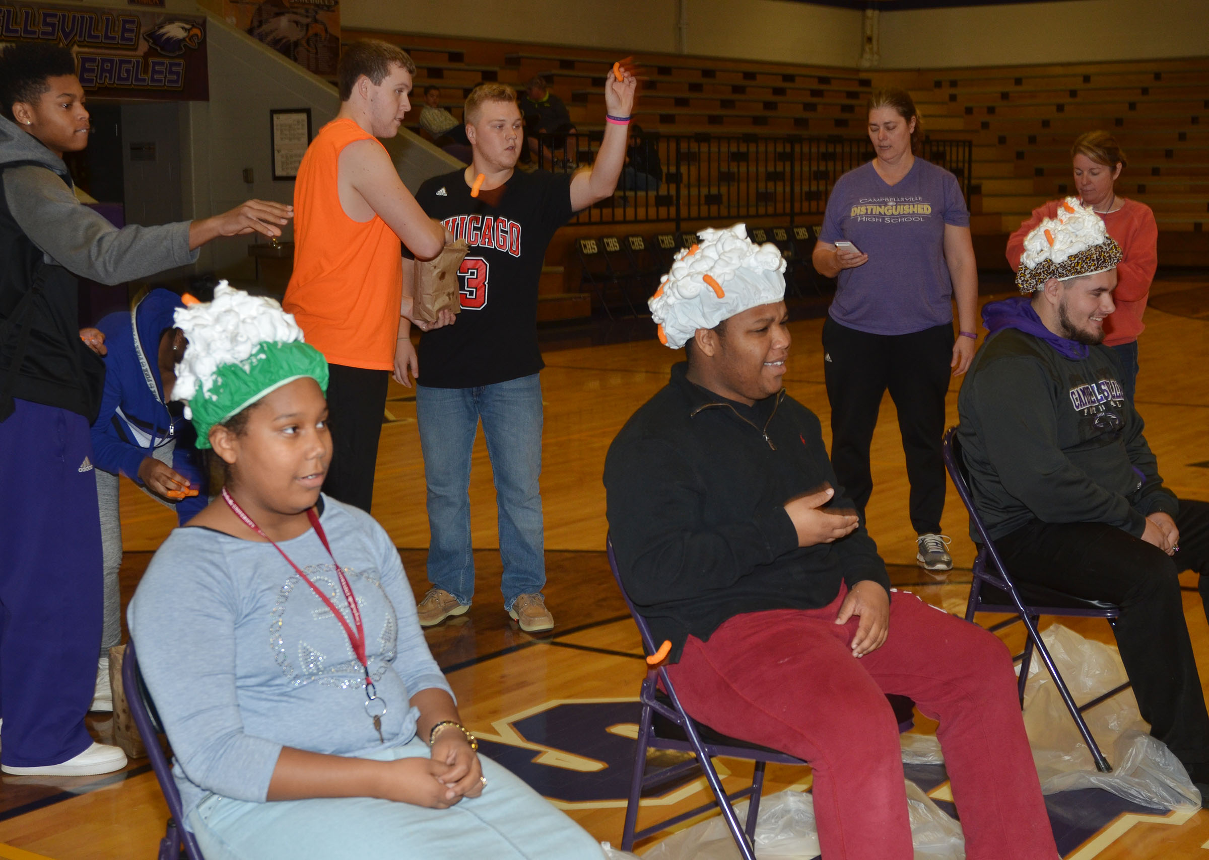CHS students play the Cheetos and shaving cream game.