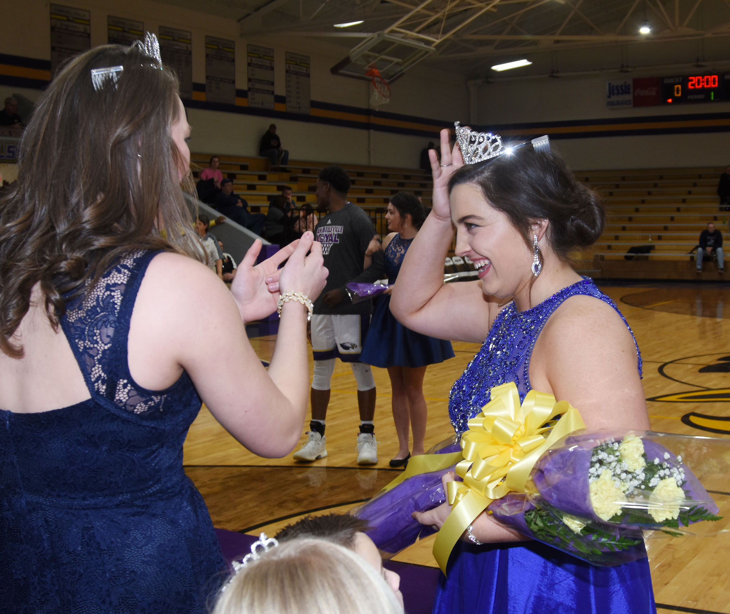Caylie Blair, last year's homecoming queen, crowns CHS senior Caitlin Bright as she is named homecoming queen.