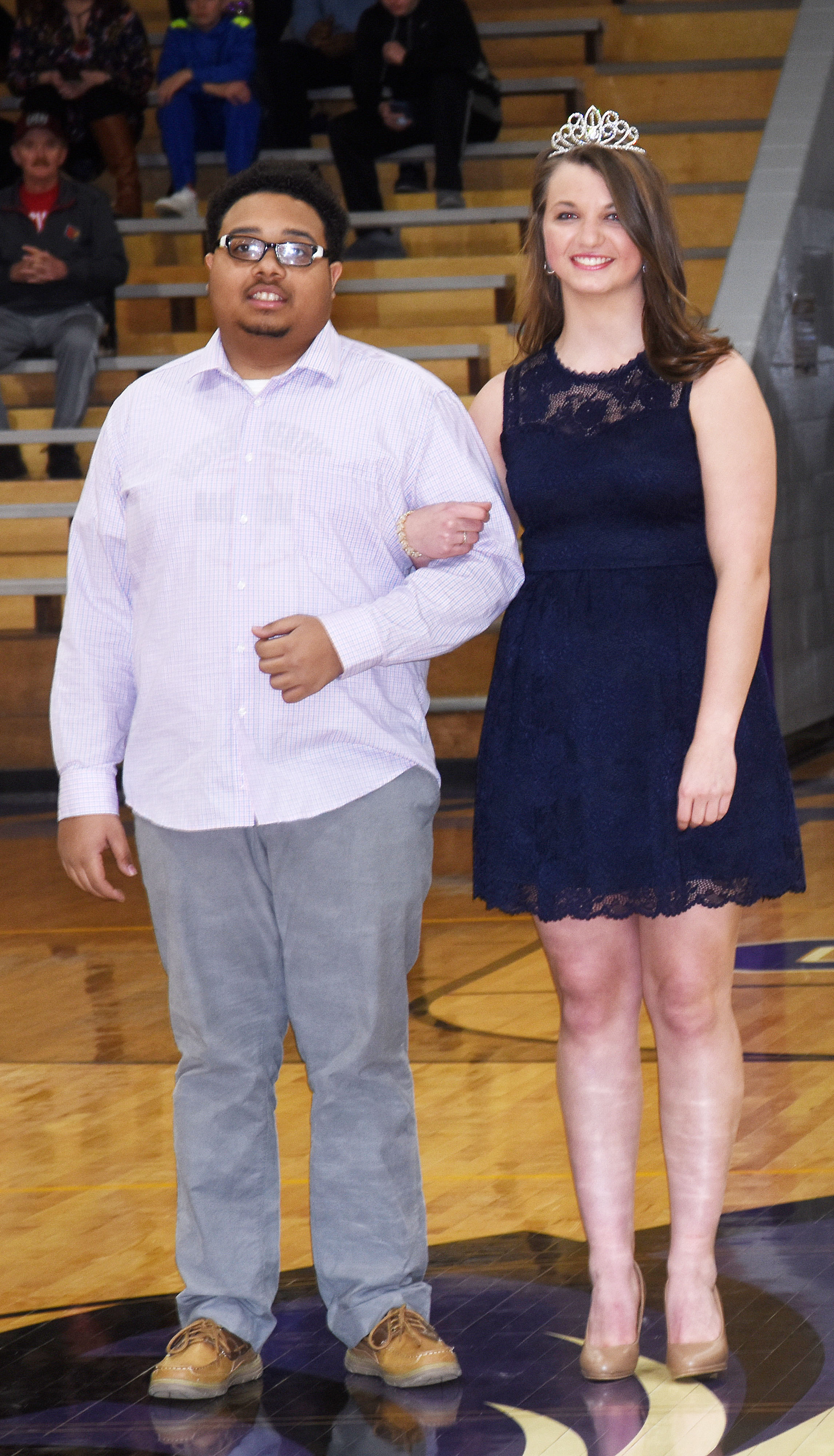 Ricky Smith-Cecil and Caylie Blair, who were named last year's basketball homecoming king and queen and graduated last May, came back to CHS to crown the new king and queen.