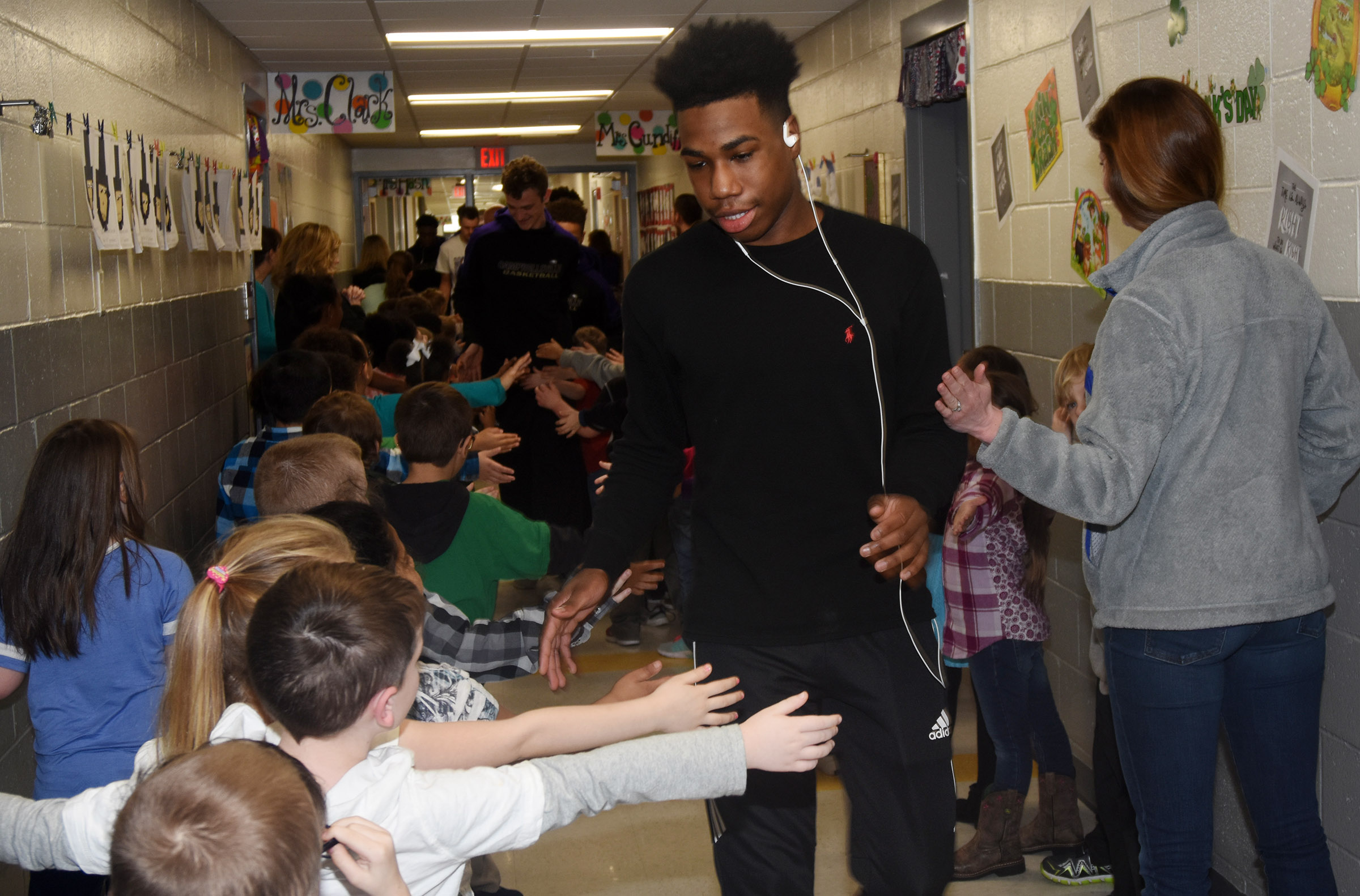 CHS sophomore Malachi Corley high-fives CES students during the Eagle Walk.
