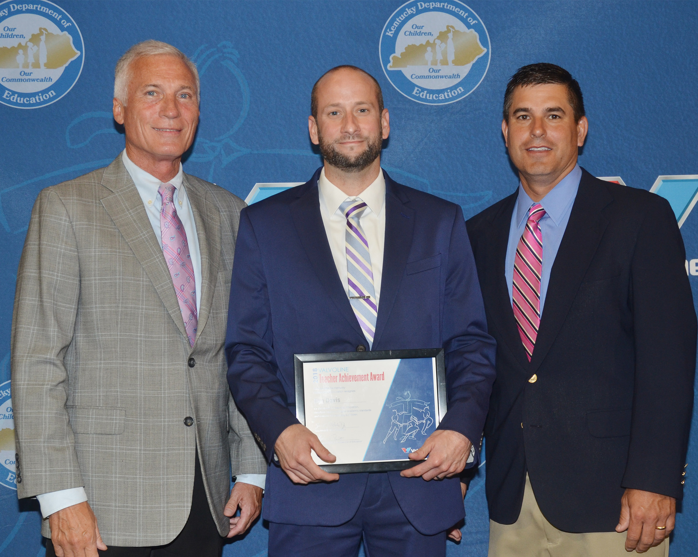 CHS teacher Ben Davis receives his Teacher Achievement Award and is pictured with Campbellsville Independent Schools Superintendent Mike Deaton, at left, and CHS Principal Kirby Smith.