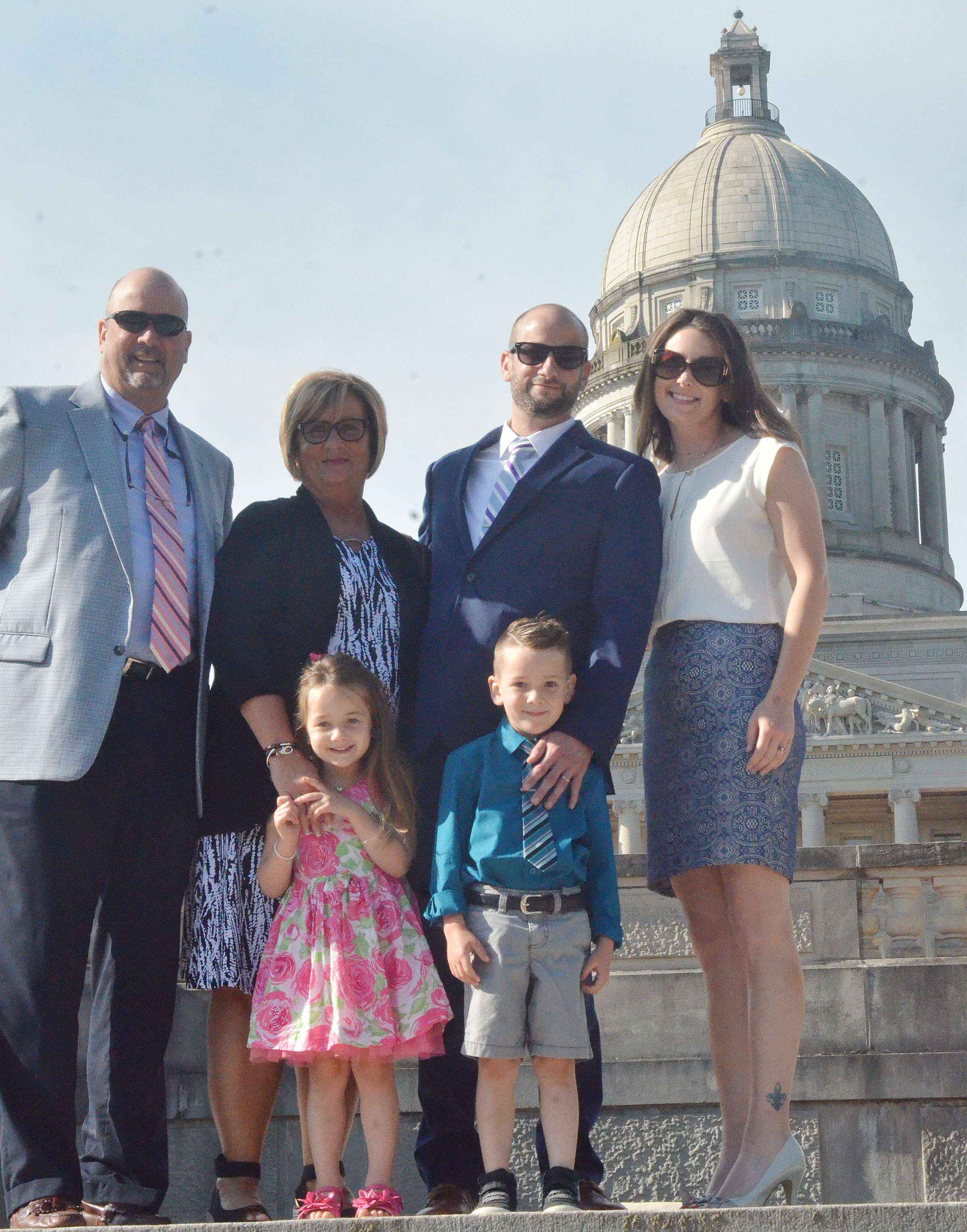 CHS teacher Ben Davis and his wife, Stephanie, pose for a photo in front of the Kentucky capitol with their children Cash and Lylah and Davis's parents, Tim, who is athletic director at CHS, and Joni, who is director of exceptional education at Campbellsville Independent Schools.