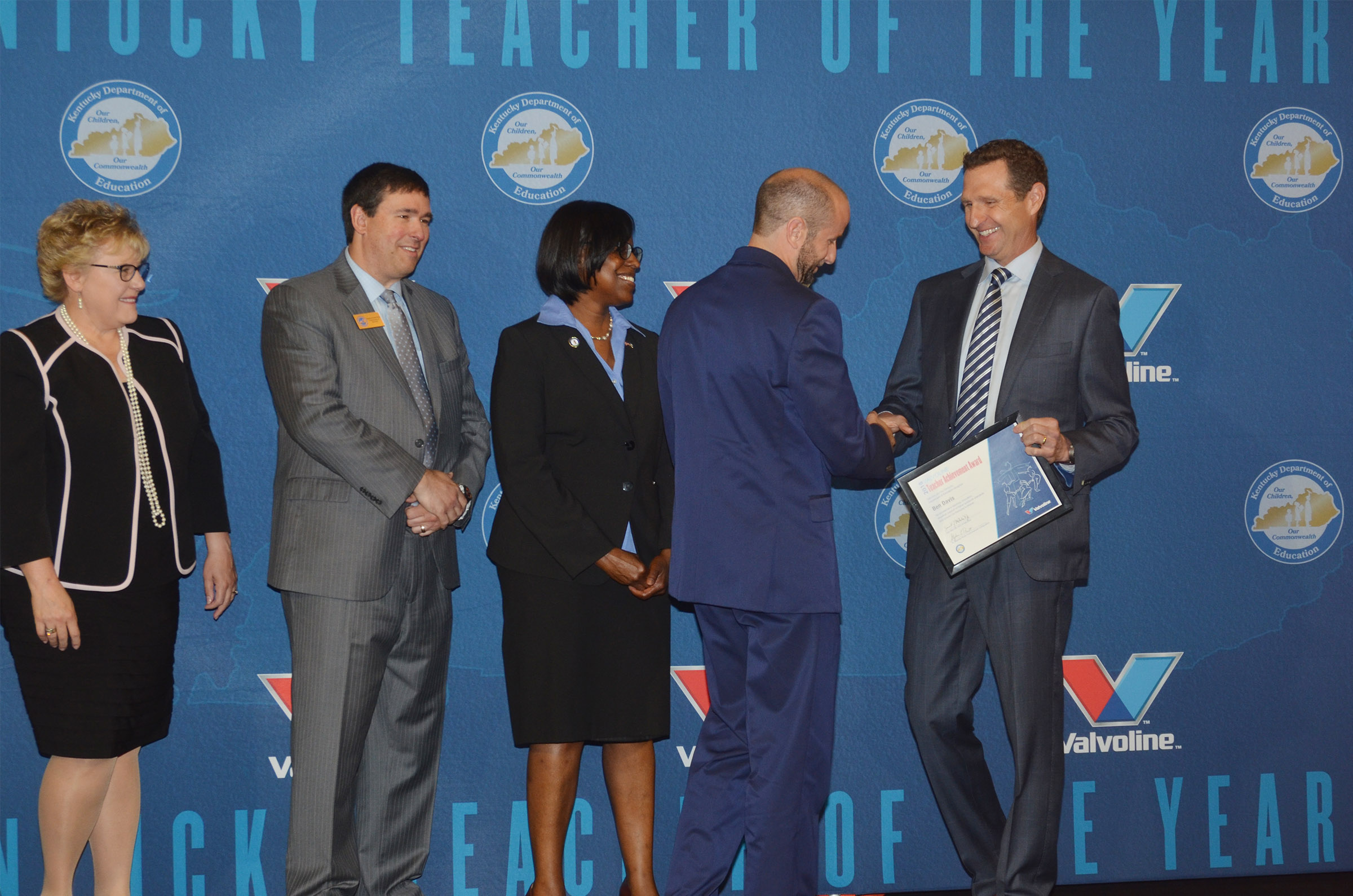 CHS teacher Ben Davis receives his Teacher Achievement Award from Sam Mitchell, chief executive officer of Valvoline. Also pictured are, from left, Mardi Montgomery, director for policy and legislation at the Kentucky Education and Workforce Development Cabinet; Commissioner of Education Dr. Stephen Pruitt; and Kentucky Lt. Gov. Jenean Hampton.