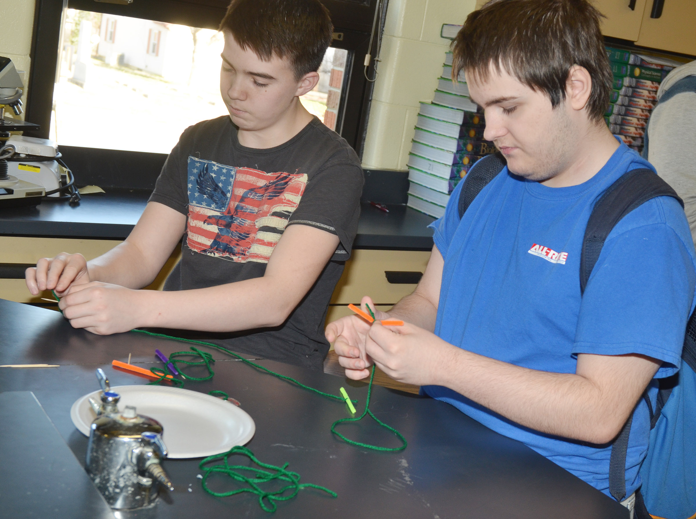 CHS freshman Cole Kidwell, at left, and Jim Jefferies cut their string to make their cell model.