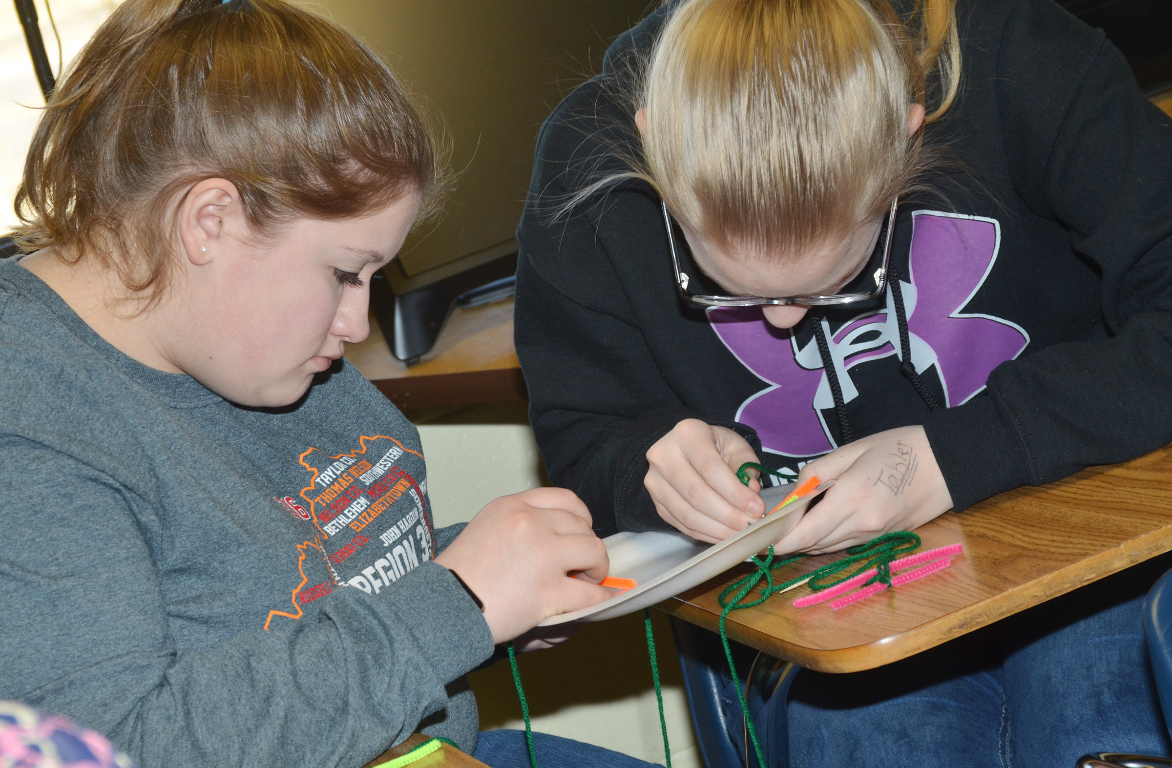 CHS freshmen Aleah Knifley, at left, and Tahler Franklin work together to make their cell model.
