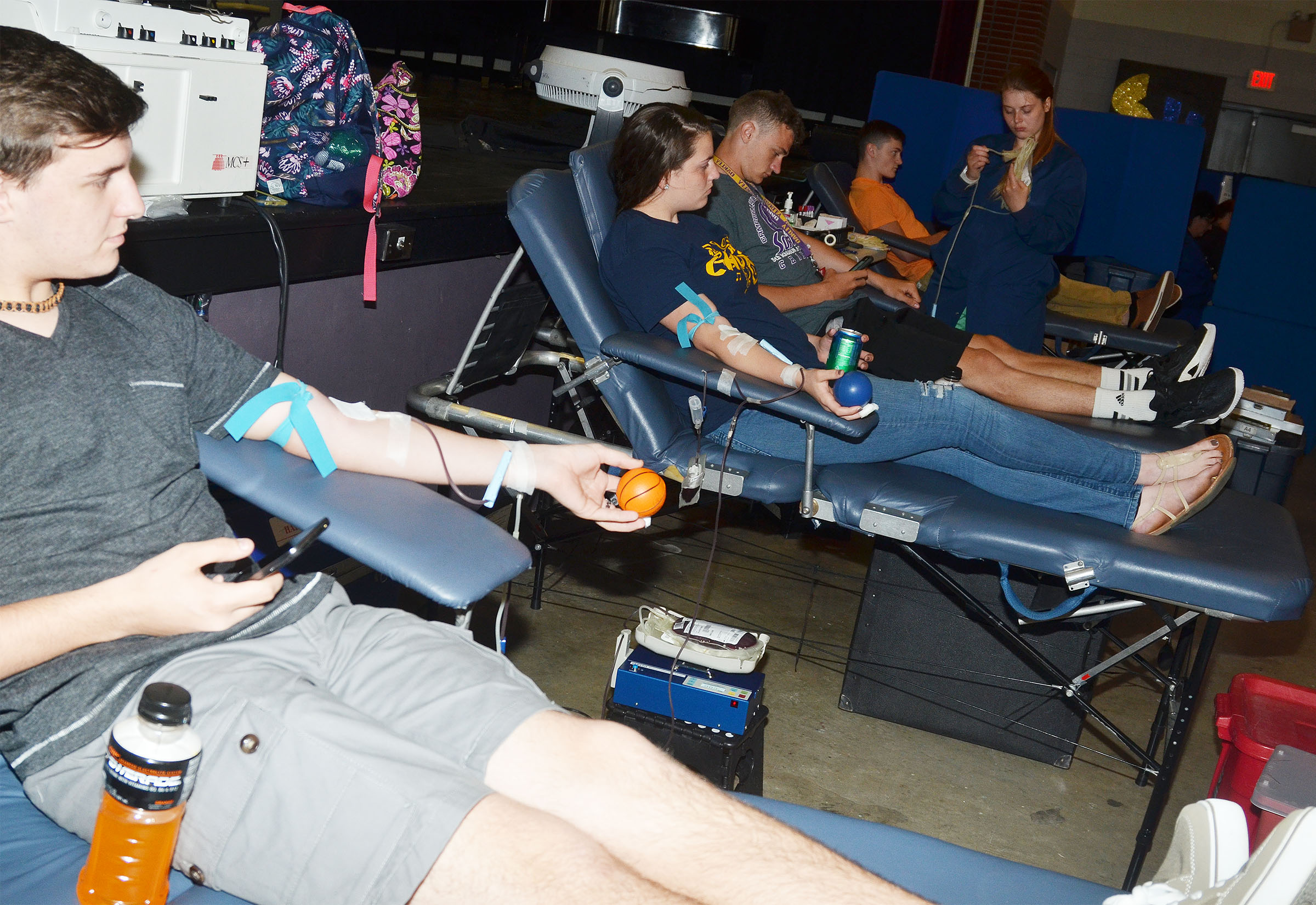 From left, CHS junior Austin Fitzgerald, sophomore Lauren Williams and juniors Connor Wilson and Bryce Richardson donate blood.