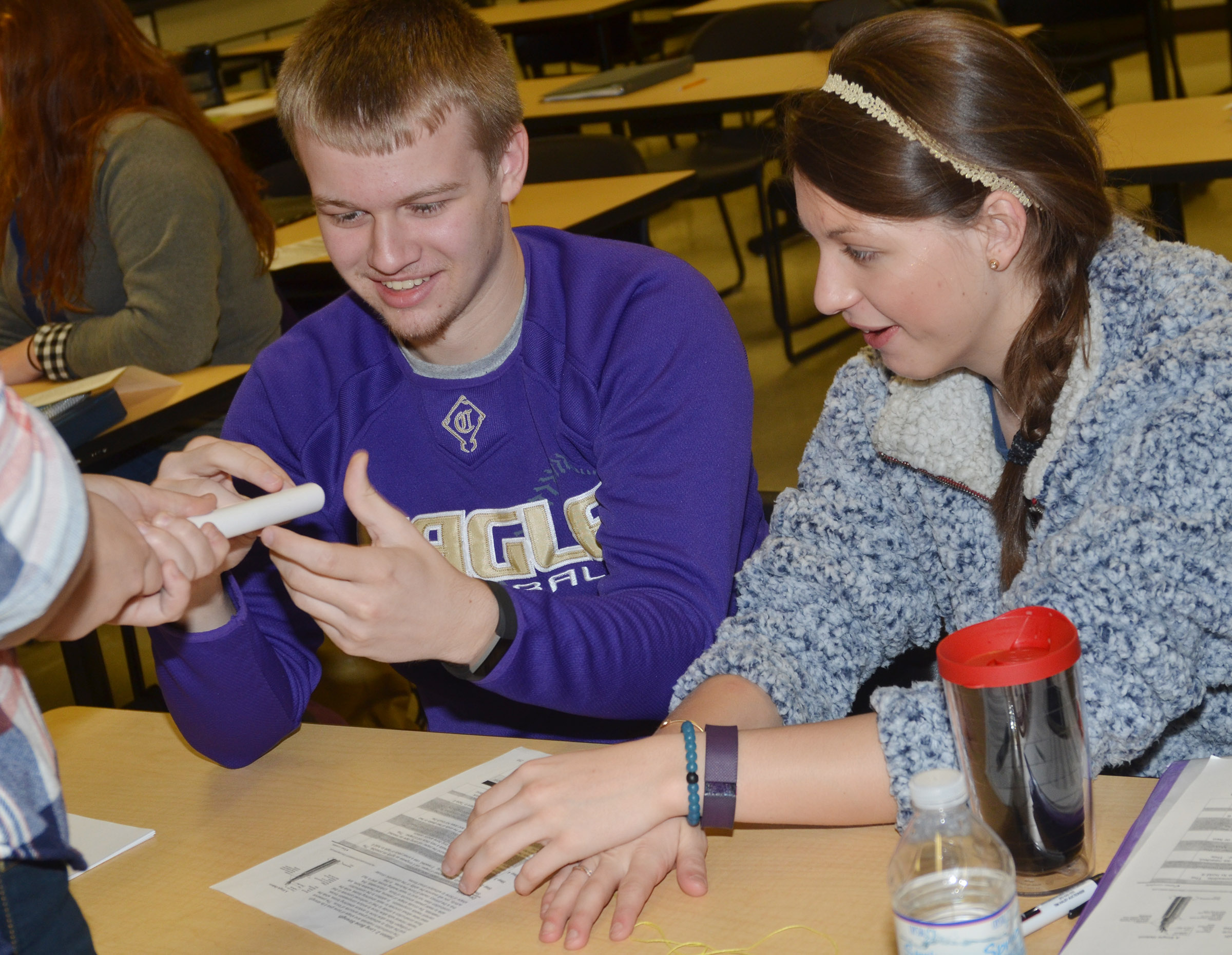 "CHS junior Wyatt Houk, at left, and senior Caylie Blair work with classmate senior Brenna Wethington to make their ""bone."""