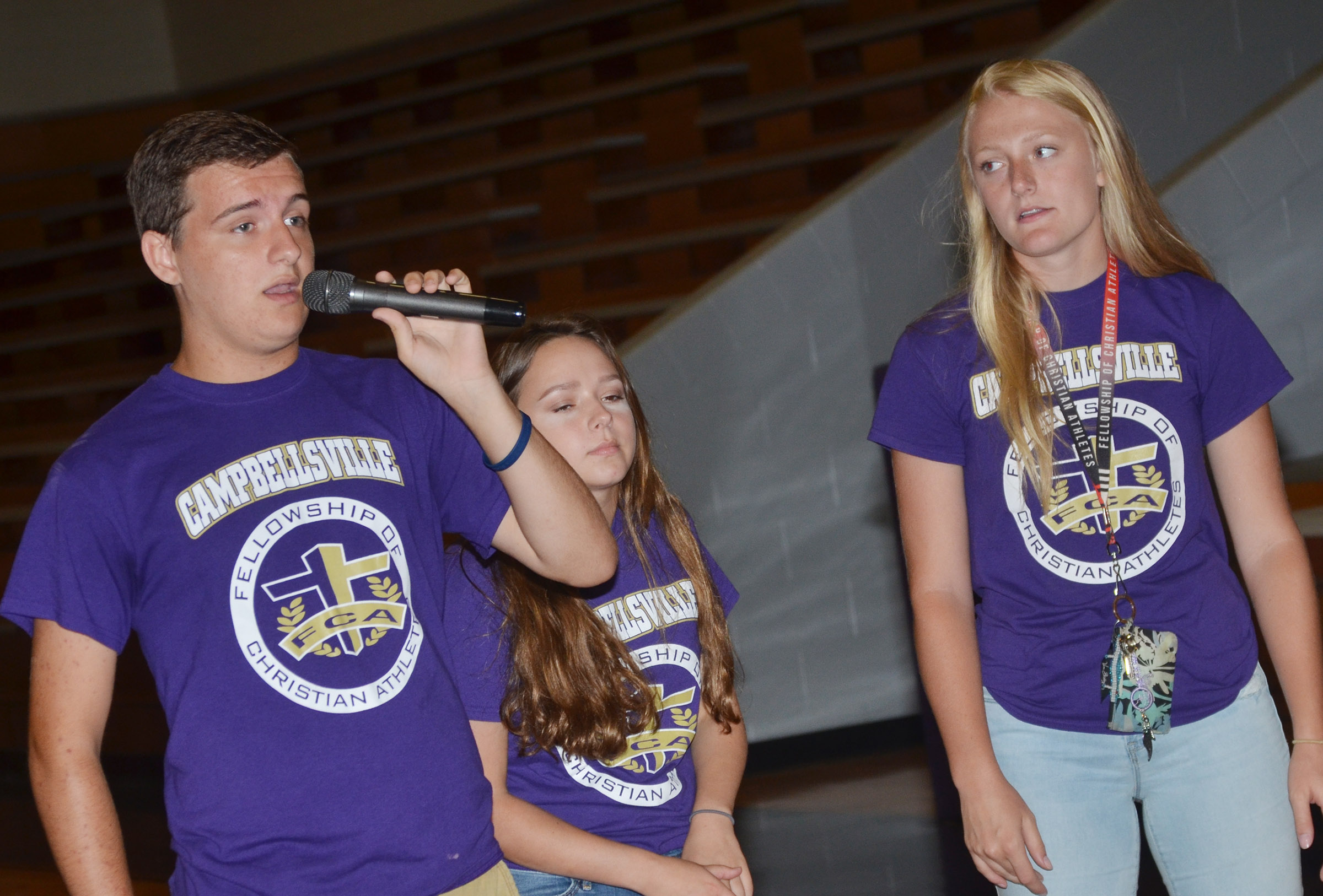 From left, CHS FCA members Austin Fitzgerald, a senior, and juniors Christa Riggs and Abbie Dicken talk to freshmen about joining FCA.