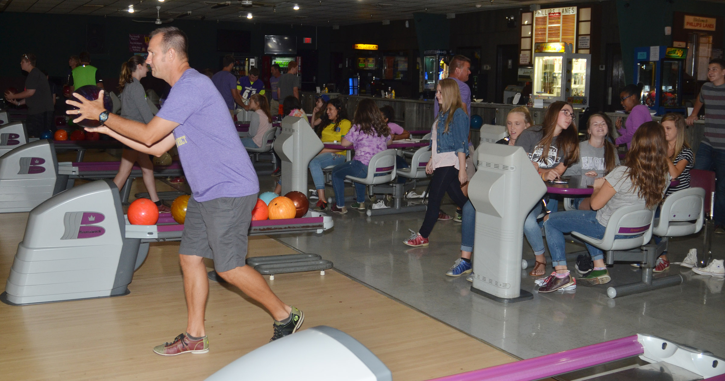 CHS exceptional child educator Steve Doss bowls with freshmen students.