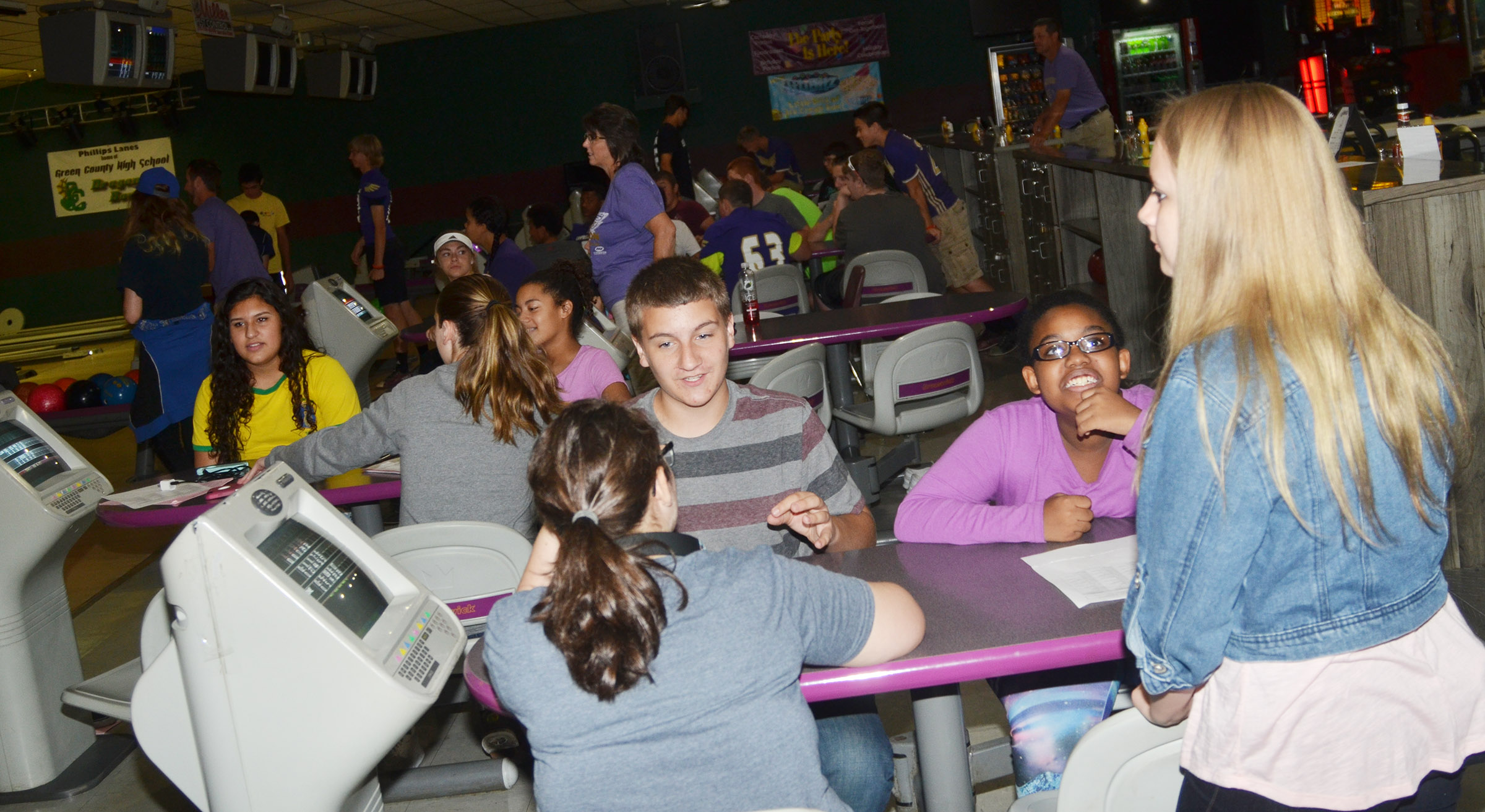 CHS freshmen talk as they bowl together.