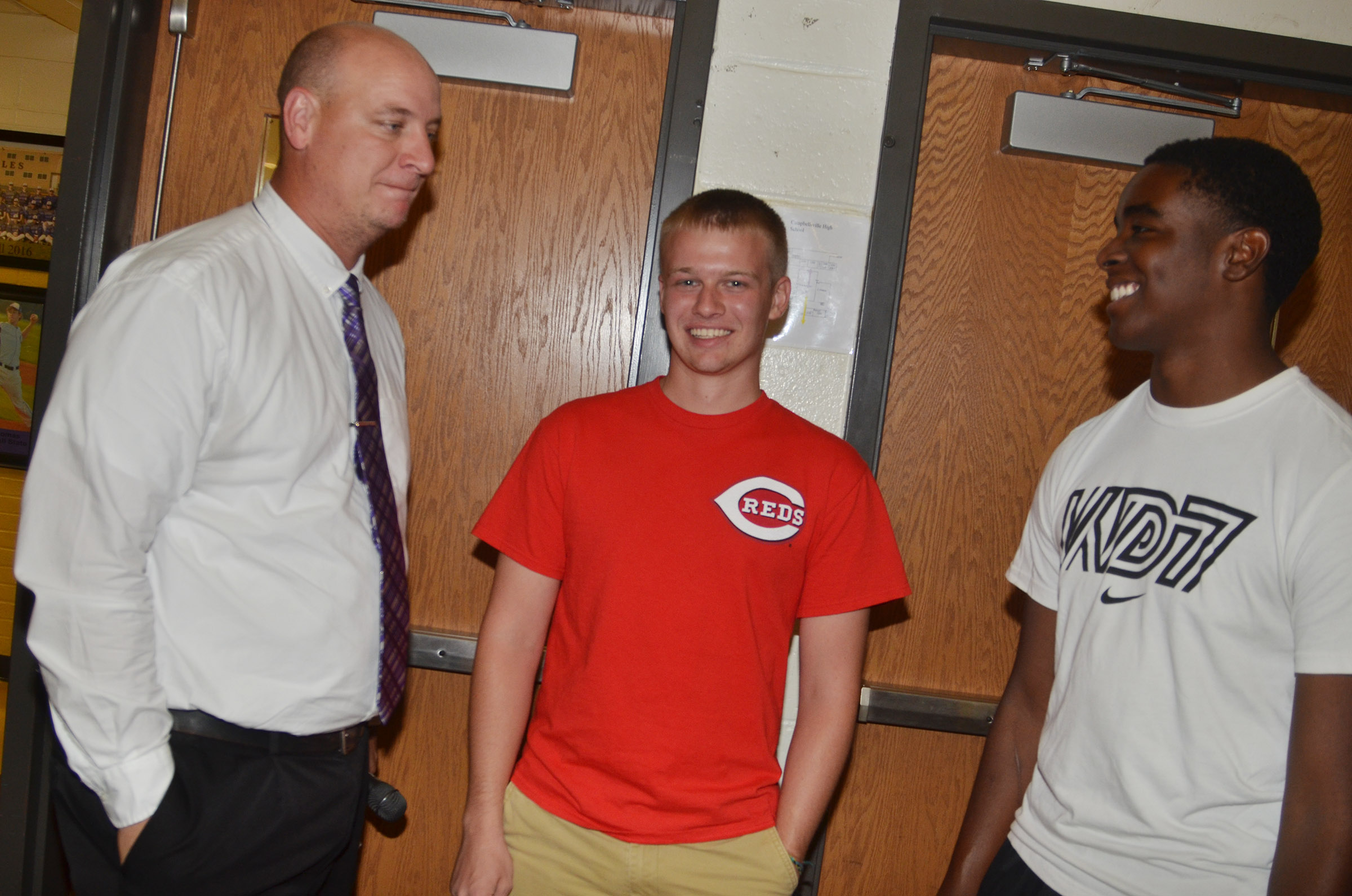 CHS Principal David Petett talks to CHS seniors Wyatt Houk, center, and Chanson Atkinson.