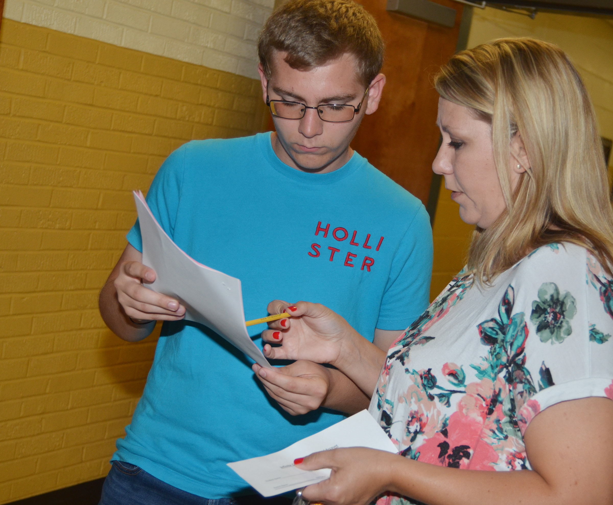 CHS junior Brandon Greer talks with his mother Amanda Greer about his schedule.