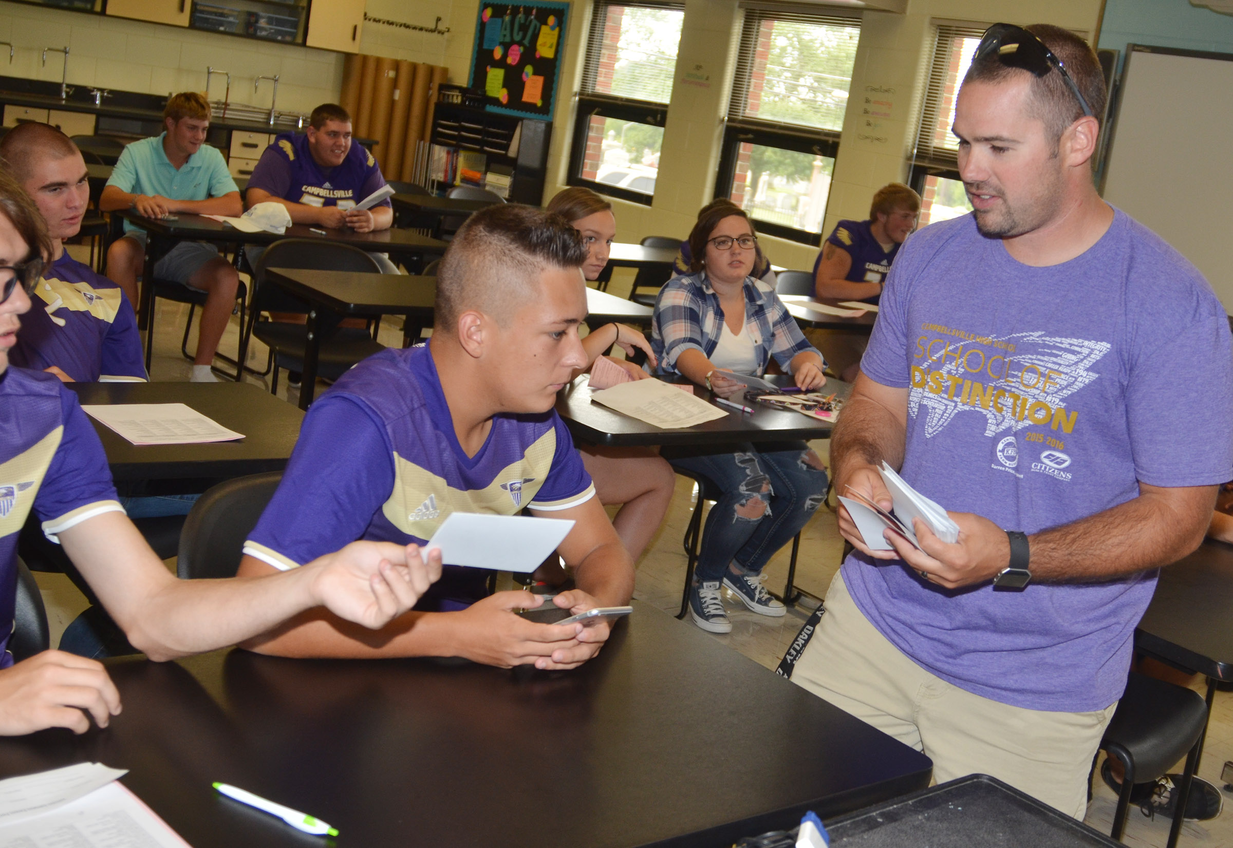 CHS teacher Blake Milby collects thank you notes from senior students.