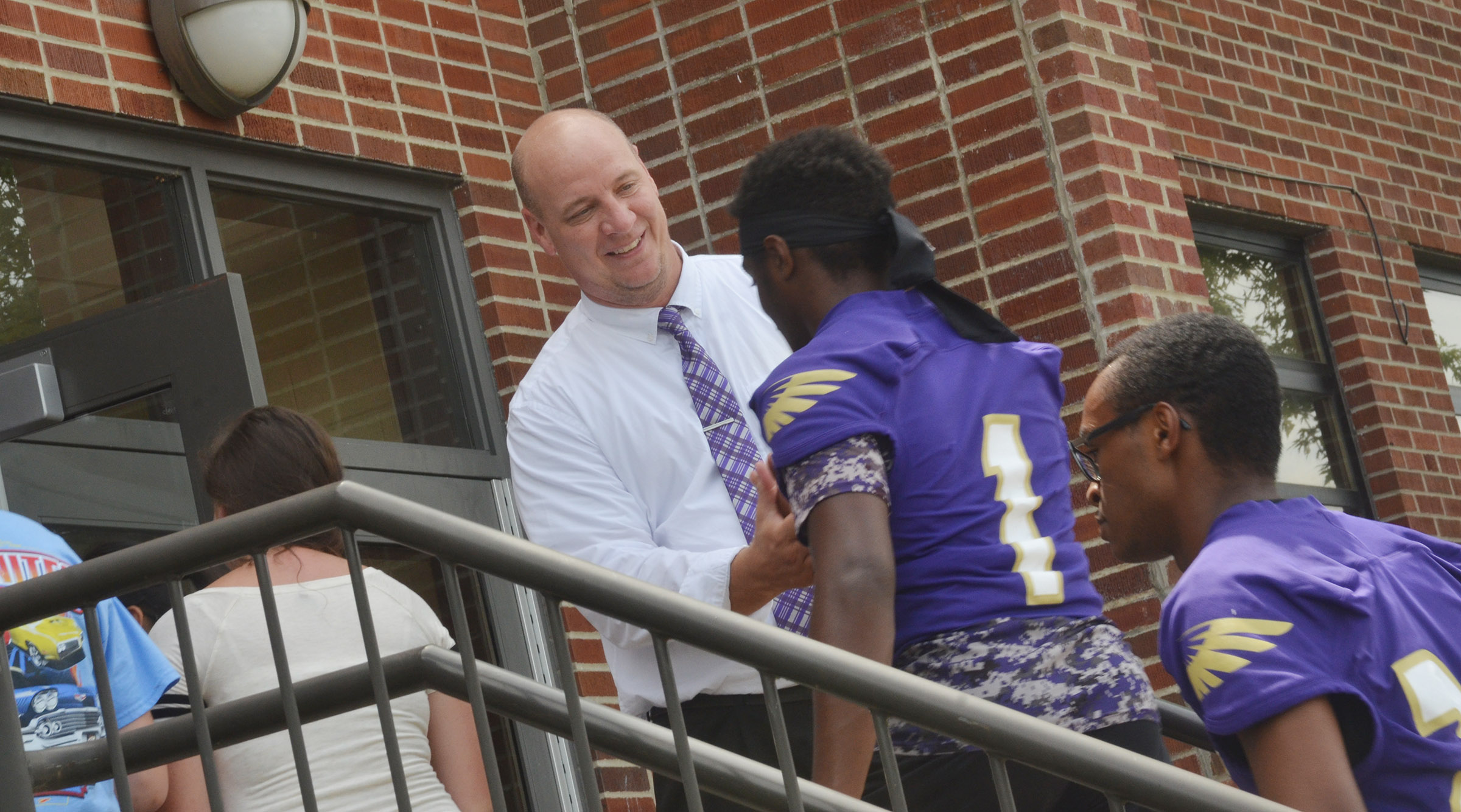 CHS Principal David Petett greets junior Charlie Pettigrew.