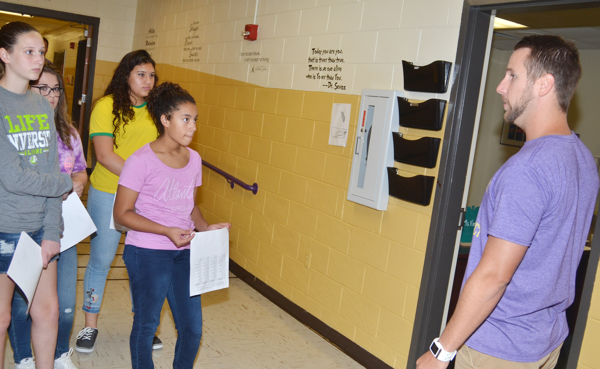CHS teacher Tyler Hardy gives freshmen a tour of the school.