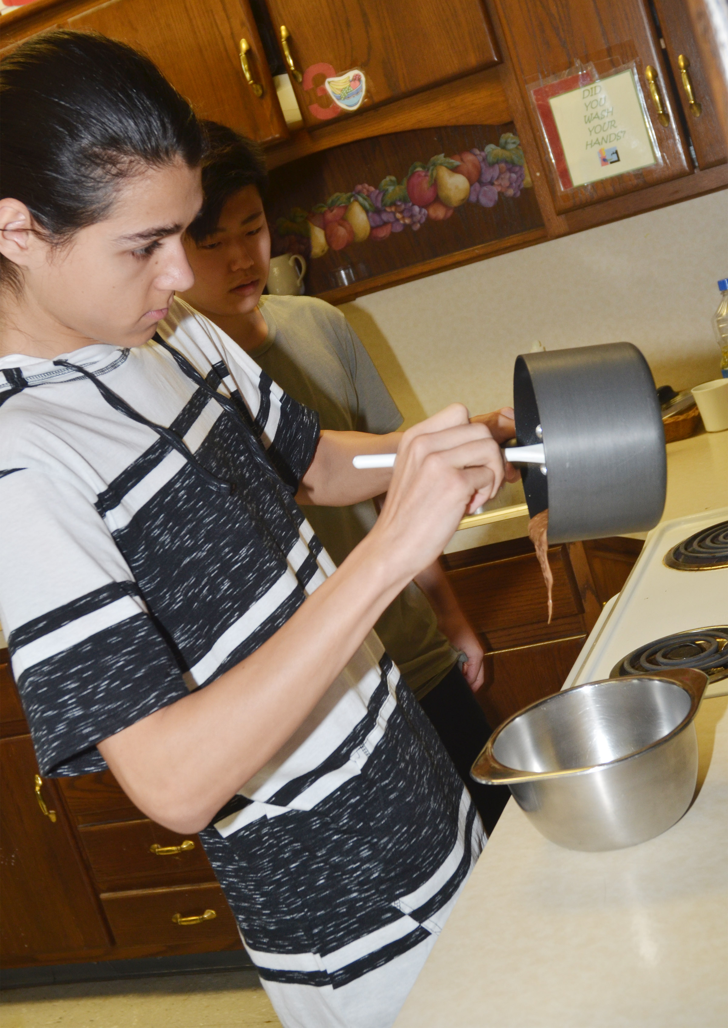 CHS senior Michael De Oliveira stirs the dessert he made for his final project.