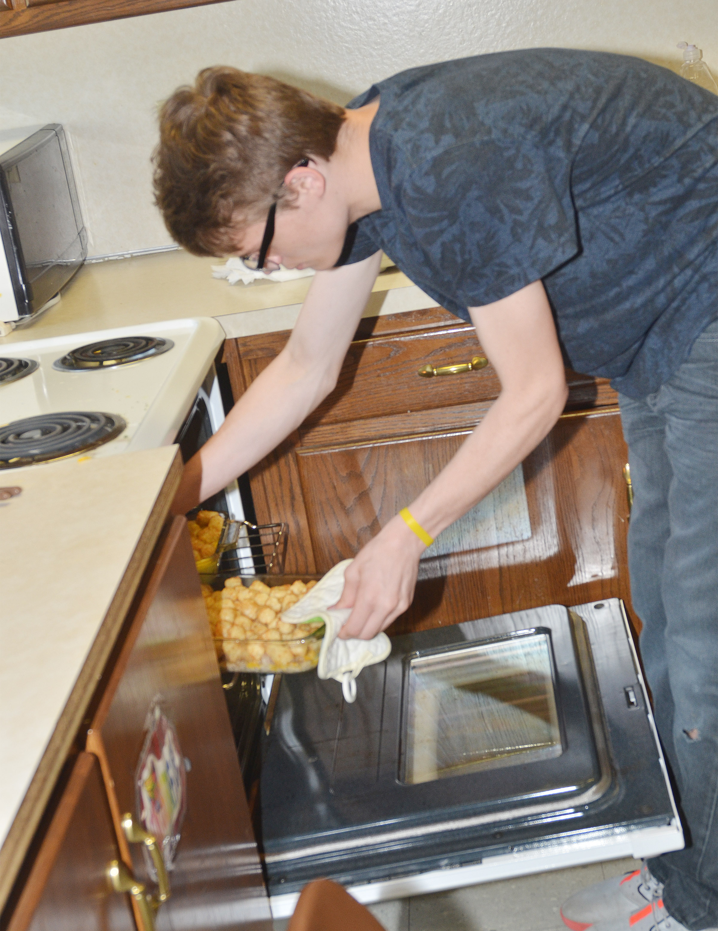 CHS sophomore Joe Pipes checks on his breakfast casserole he made for his final project.