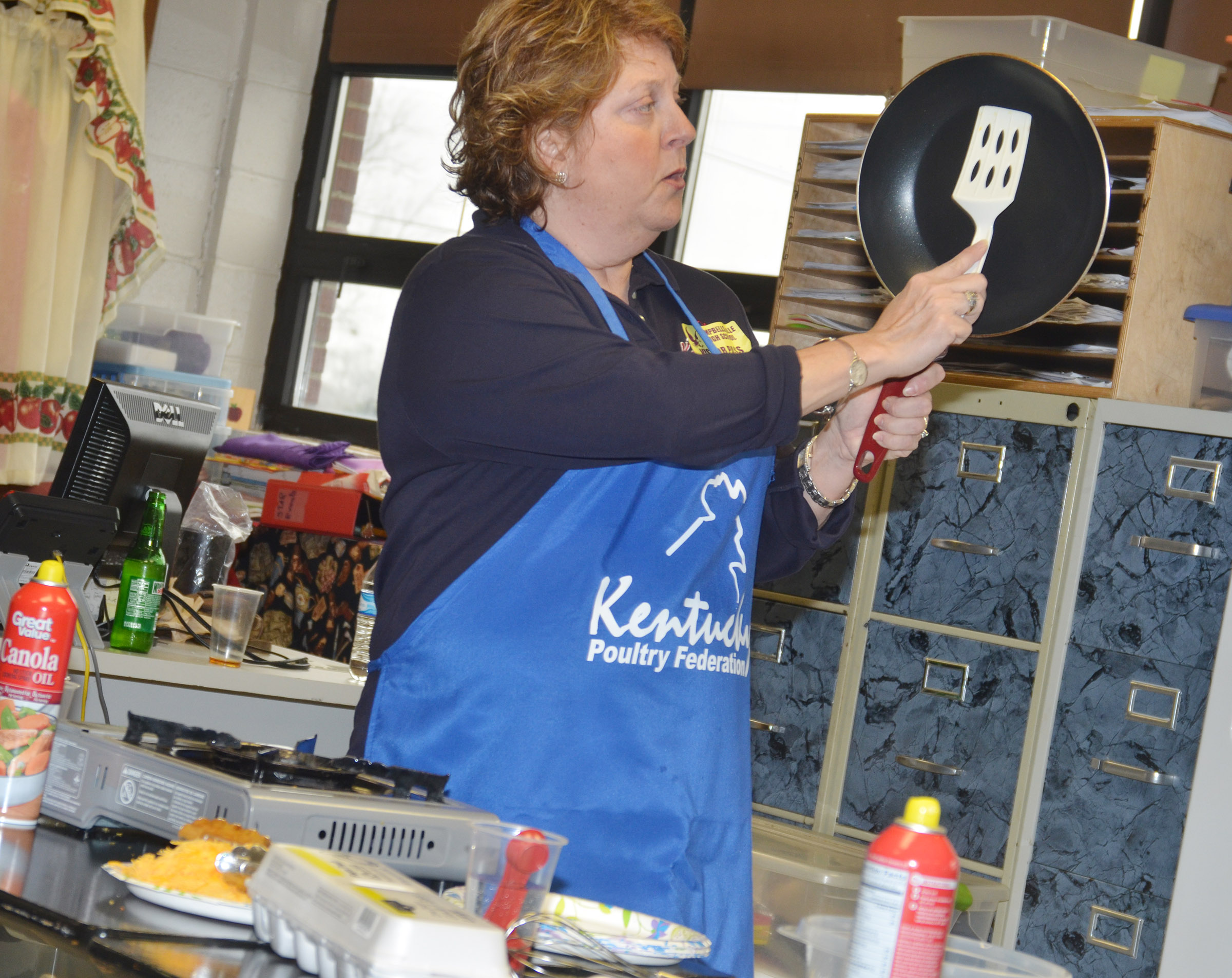 "Cassinda Bechanan, promotions coordinator with the Kentucky Poultry Federation, known around the state as the ""Egg Lady,"" talks to CHS students about how to make an omelet."