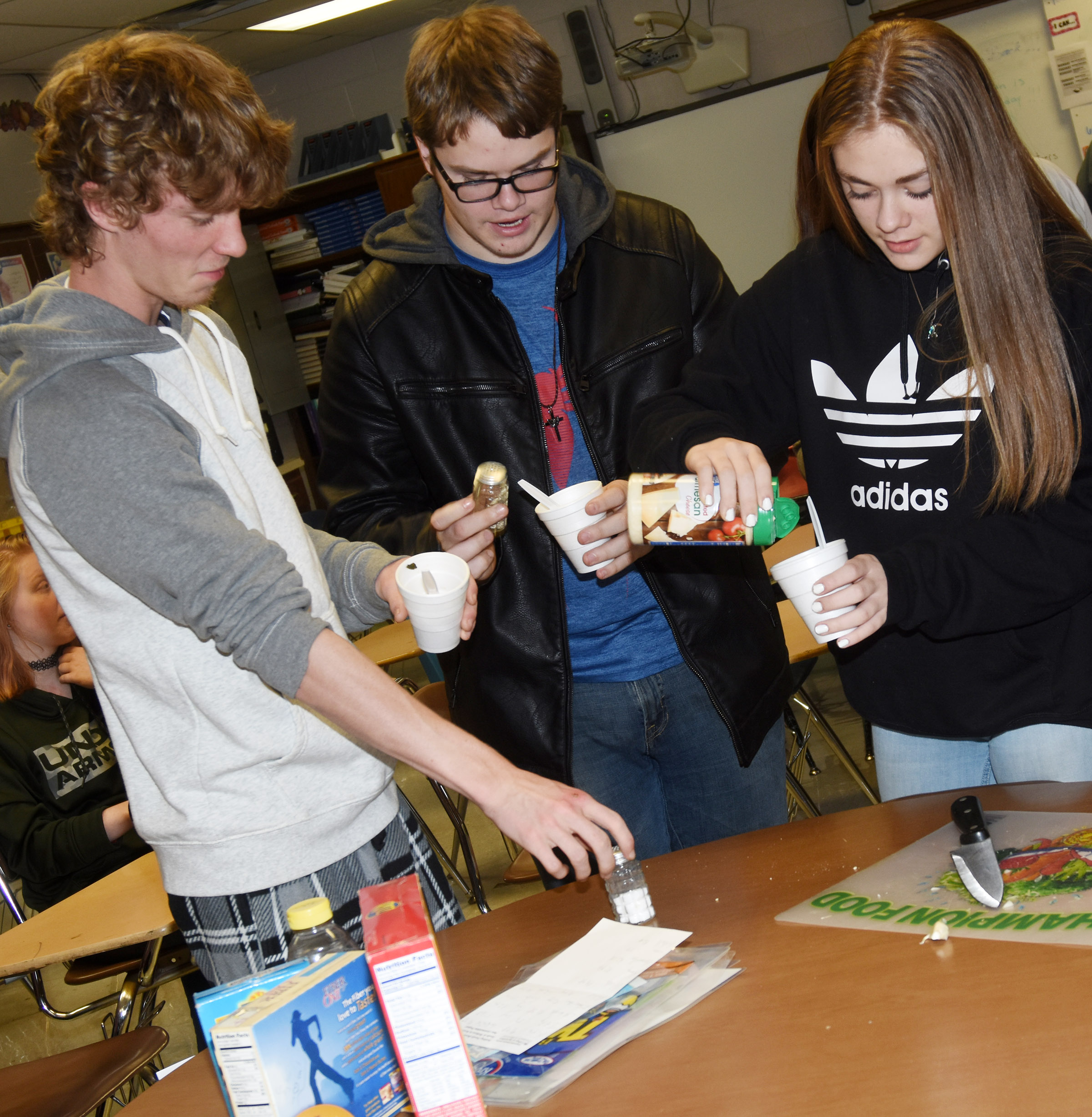 From left, CHS juniors Payton Reynolds and John Netherland and freshman Emily Kerns sample the class's bean soup.